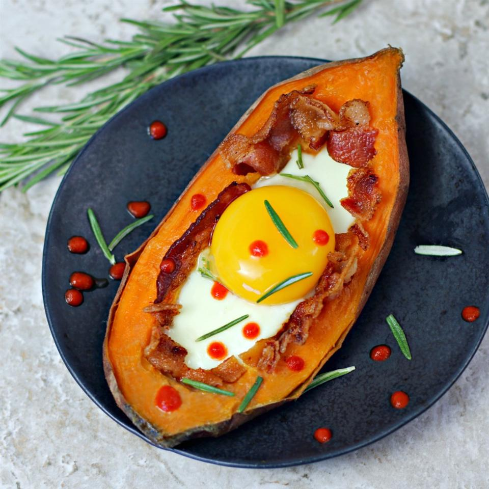 If you're looking for a filling, easy, cheap, and healthy sweet potato breakfast or brunch dish - this is it! Tender baked sweet potatoes are sliced in half and stuffed with bacon and an egg for an incredibly tasty dish to share with friends.