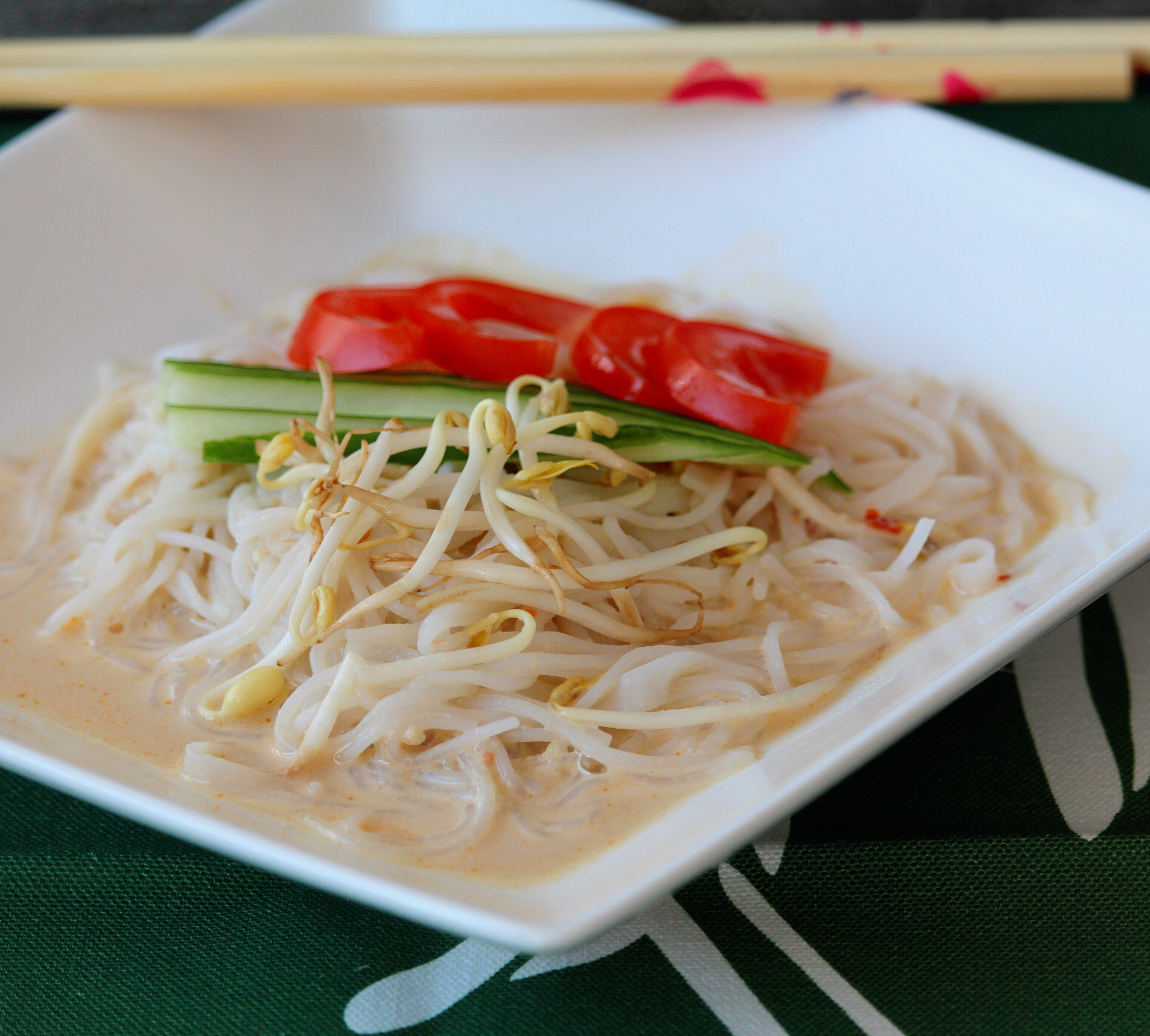 Soybeans are cooked and pureed to make the base for this healthy cold soup; pour over your favorite type of noodles and top with tomato, cucumber, and sesame seeds to make this popular Korean summertime dish.