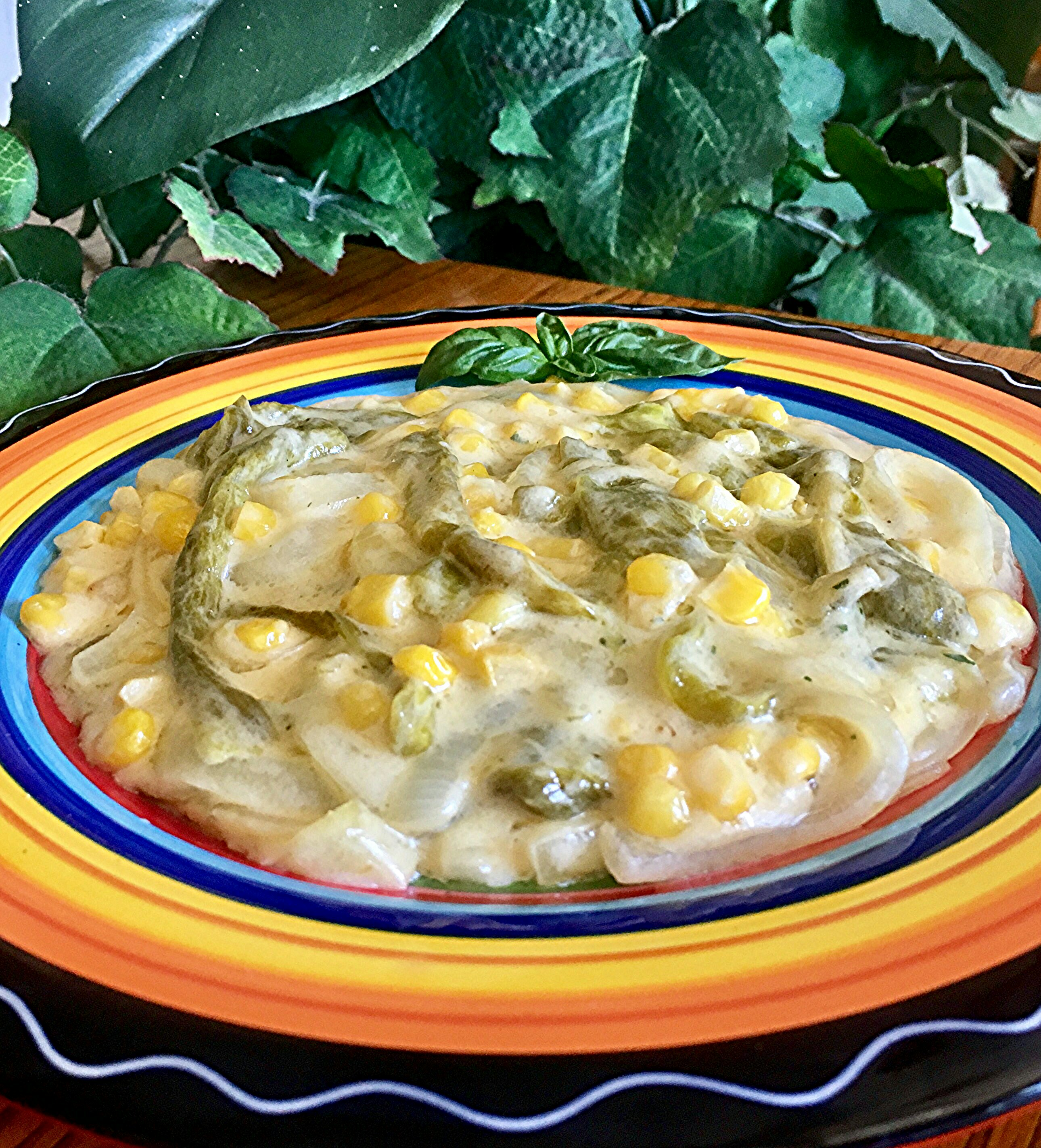 "Roasted poblano peppers and sweet corn simmer in a sauce made with cream and Mexican manchego cheese. ""A deliciously easy Mexican staple,"" says Ainé. ""Mexican manchego is very different than Spanish manchego. It can be replaced with Chihuahua cheese, another Mexican variety. In a pinch you can use a mild Cheddar cheese."""