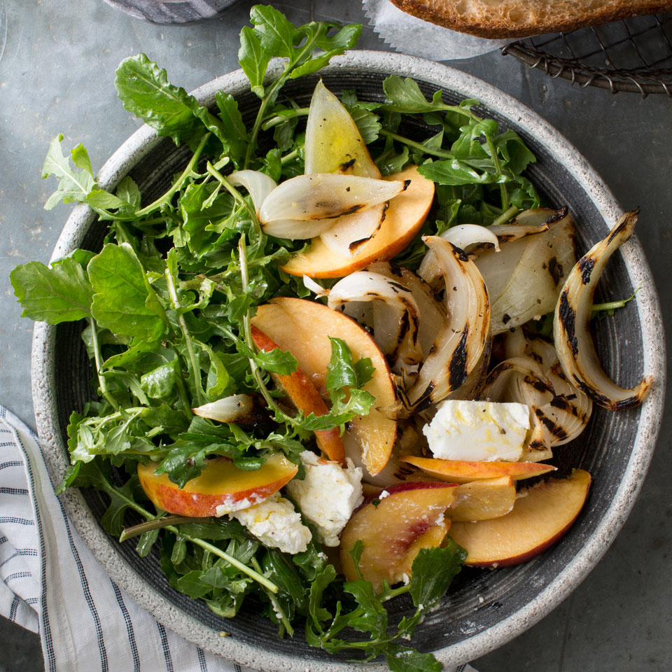 For this healthy salad recipe, Chef Satterfield grills the onion in large wedges so the edges are crispy and the centers are soft and sweet. Pair with grilled chicken or pork, or take to a potluck and toss with the vinaigrette just before serving.Source: EatingWell Magazine, May/June 2017