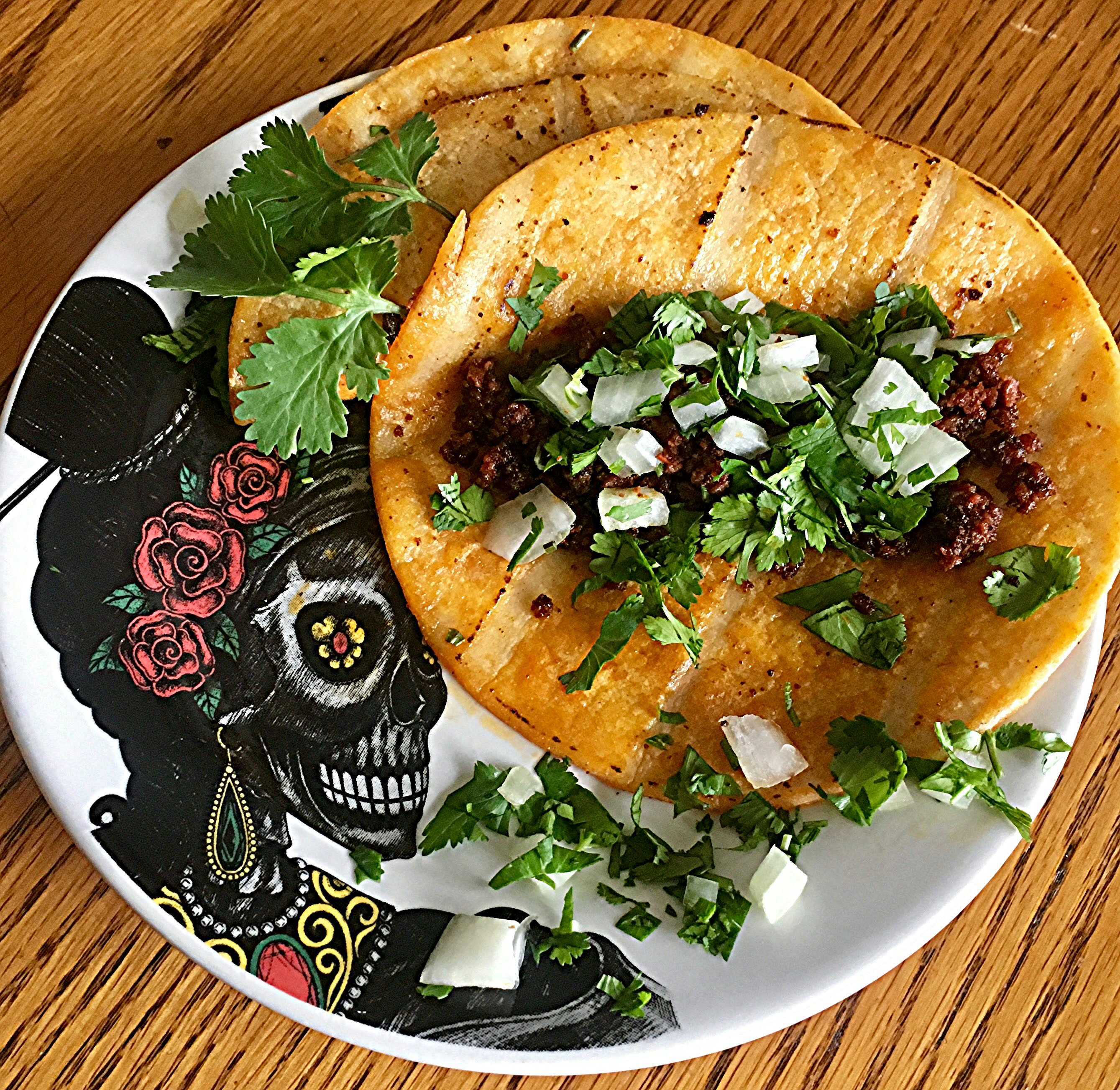 "Ready in 20 minutes. These 5-ingredients chorizo sausage tacos are topped with cilantro and onion. ""I loved these tacos! But then again, I love anything and everything with Mexican Chorizo,"" says Yoly. ""I like the concept of dipping the tortilla in the chorizo grease. A little messy but delicious."""
