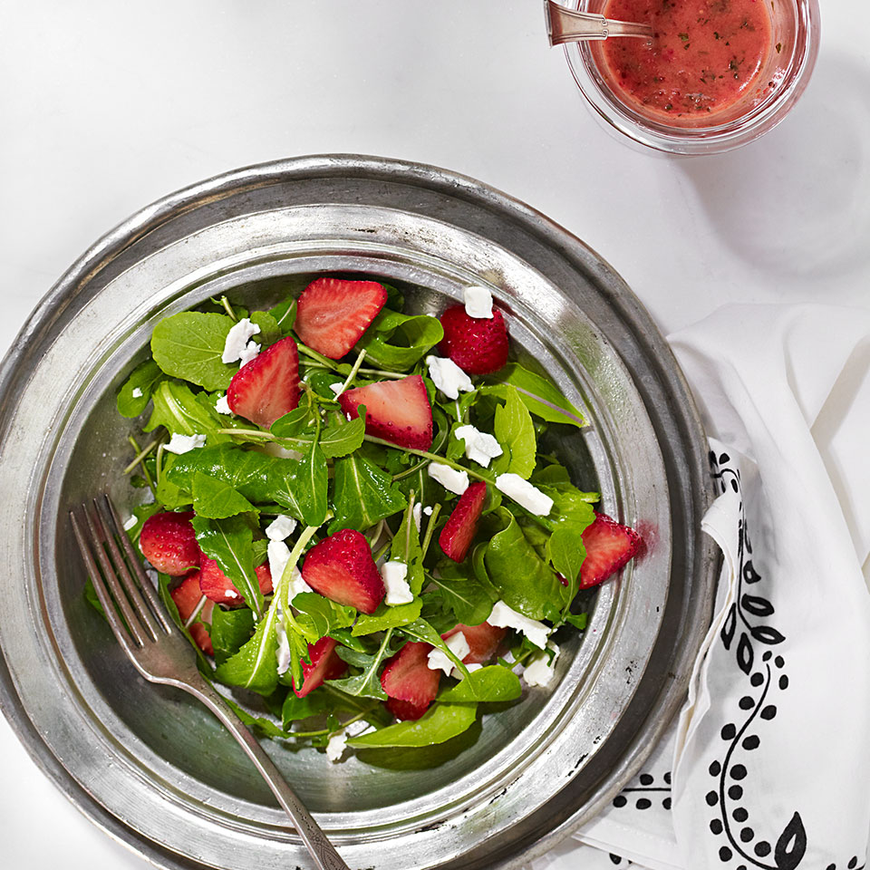 This fresh arugula and feta salad recipe is dressed with a tangy strawberry vinaigrette made from a base of fresh pureed strawberries. If you can't find the sweetest strawberries, don't worry--strawberries with a little more pucker are wonderfully suited to salads, salad dressings and vinaigrette recipes, as we use them here. Source: EatingWell Magazine, May/June 2013