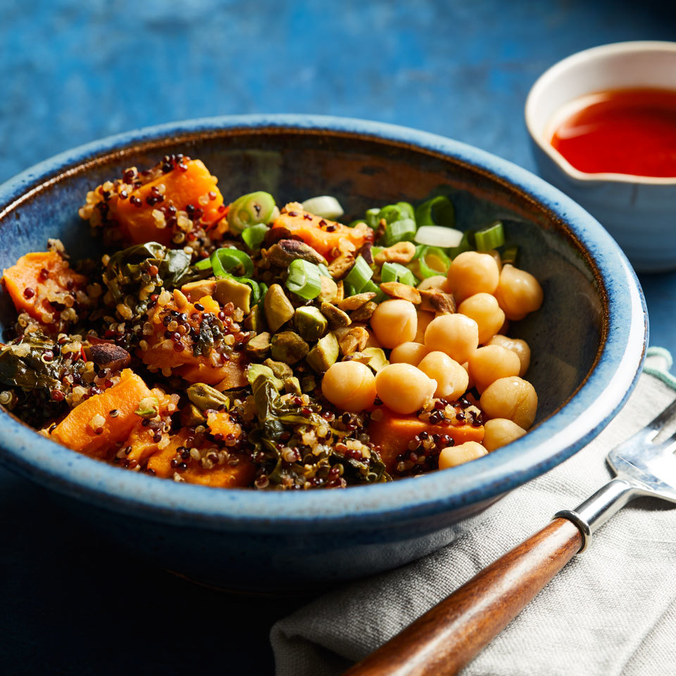 Whip up this healthy vegetarian grain bowl with ease in your Instant Pot. Pressure-cooking the sweet potato is faster and yields the perfect texture. A drizzle of homemade spicy dressing takes this easy dinner to the next level.