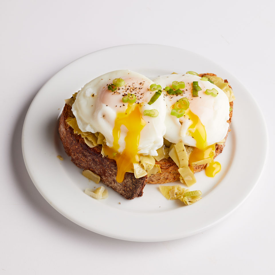 For a Mediterranean-inspired breakfast, serve up fried or poached eggs on top of sautéed artichokes and toast. If you can't find frozen, be sure to rinse canned artichoke hearts well--they're saltier than frozen. Serve with hot sauce on the side, if desired. Source: EatingWell Magazine, July/August 2017
