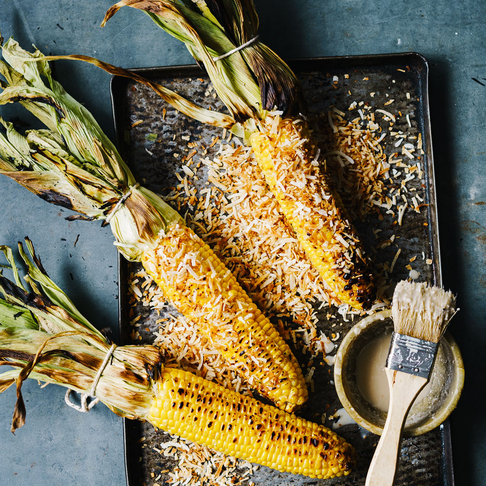 Grilled corn turns up across the globe, from Japan's supernaturally sweet Hokkaido corn to Mexico's elote, grilled corn slathered with mayonnaise and grated Cotija cheese. In this healthy corn on the cob recipe, the corn takes its inspiration from Cambodia's pod oeng, corn grilled with pandan leaf–flavored coconut milk. Source: EatingWell Magazine, July/August 2017