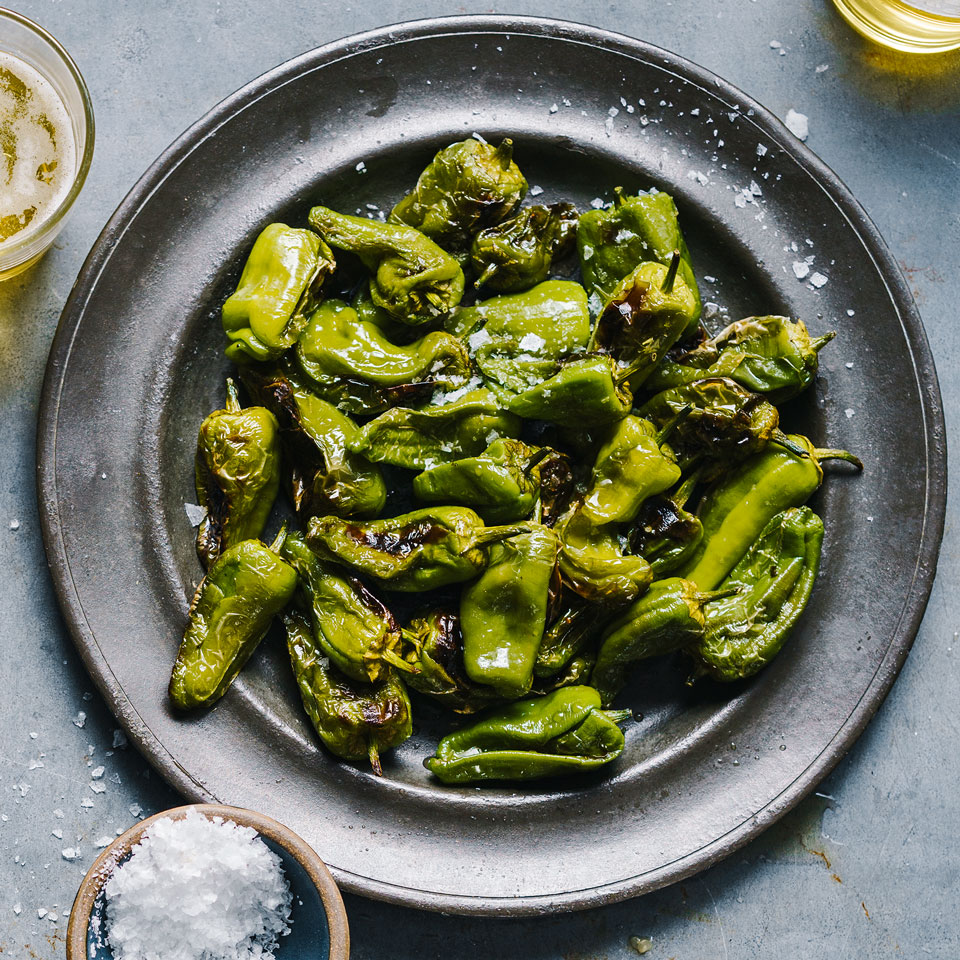Padrón peppers have a poblano-like flavor and can be as mild as a bell pepper or as fiery as a habanero (or anywhere in between). Serve the grilled peppers with other tapas, like cheese, salumi, olives and Marcona almonds. Source: EatingWell Magazine, July/August 2017