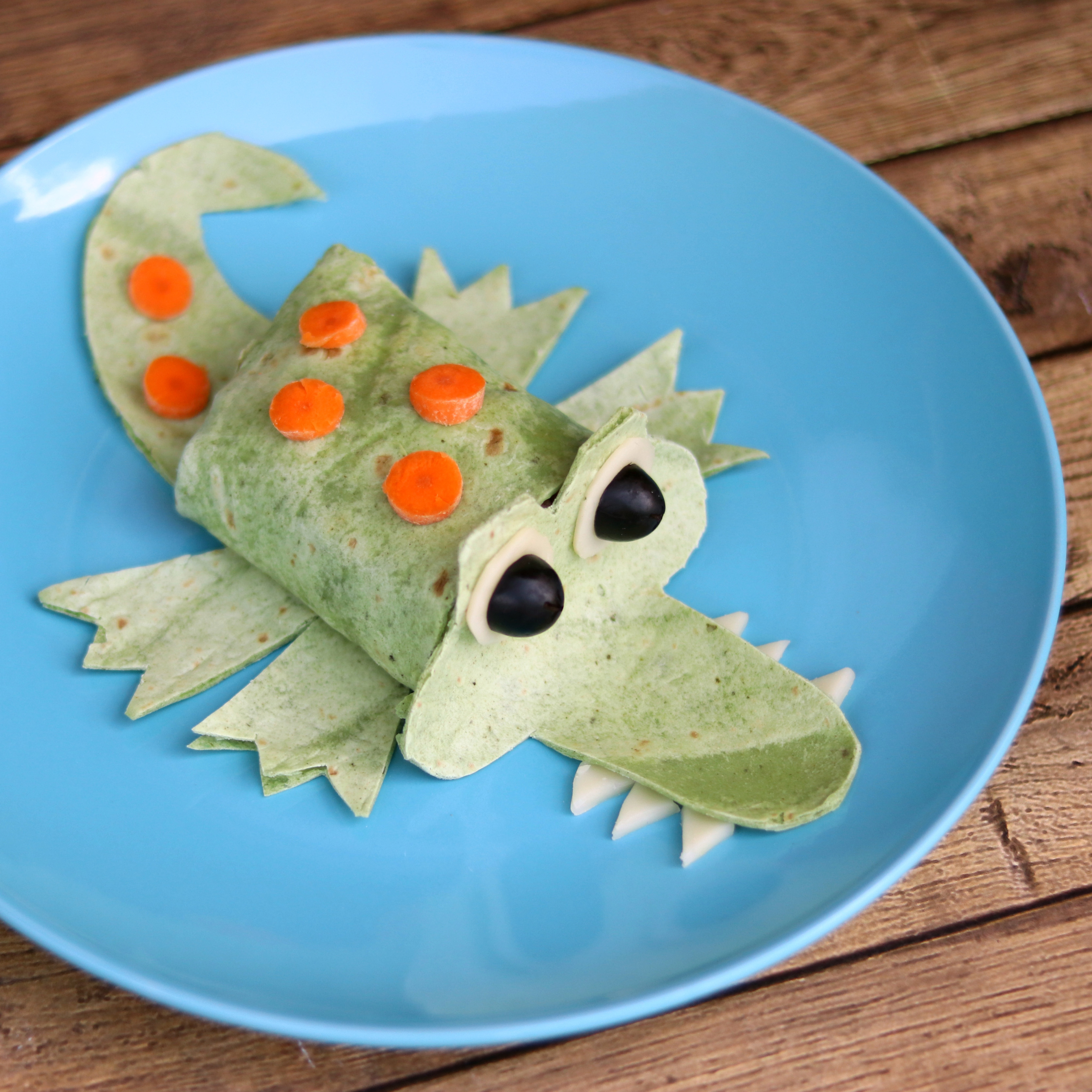There's nothing wrong with having a little fun while you eat! Use a green spinach wrap to make this chicken and avocado wrap look like an alligator for a fun lunch to pack for your kids' school lunch. (Just remember to warn them about the toothpicks holding the alligator's eyes in place.) Source: EatingWell.com, July 2017