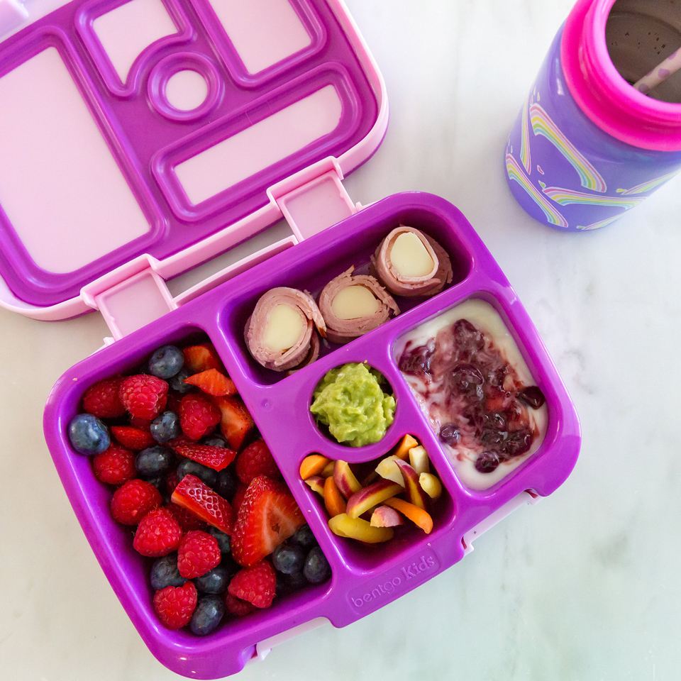 This bento box idea makes lunch fun. With its colorful carrots and swirled yogurt, this packable lunch is a healthy meal kids will actually want to eat--no more half-eaten lunches. Source: EatingWell.com, July 2017
