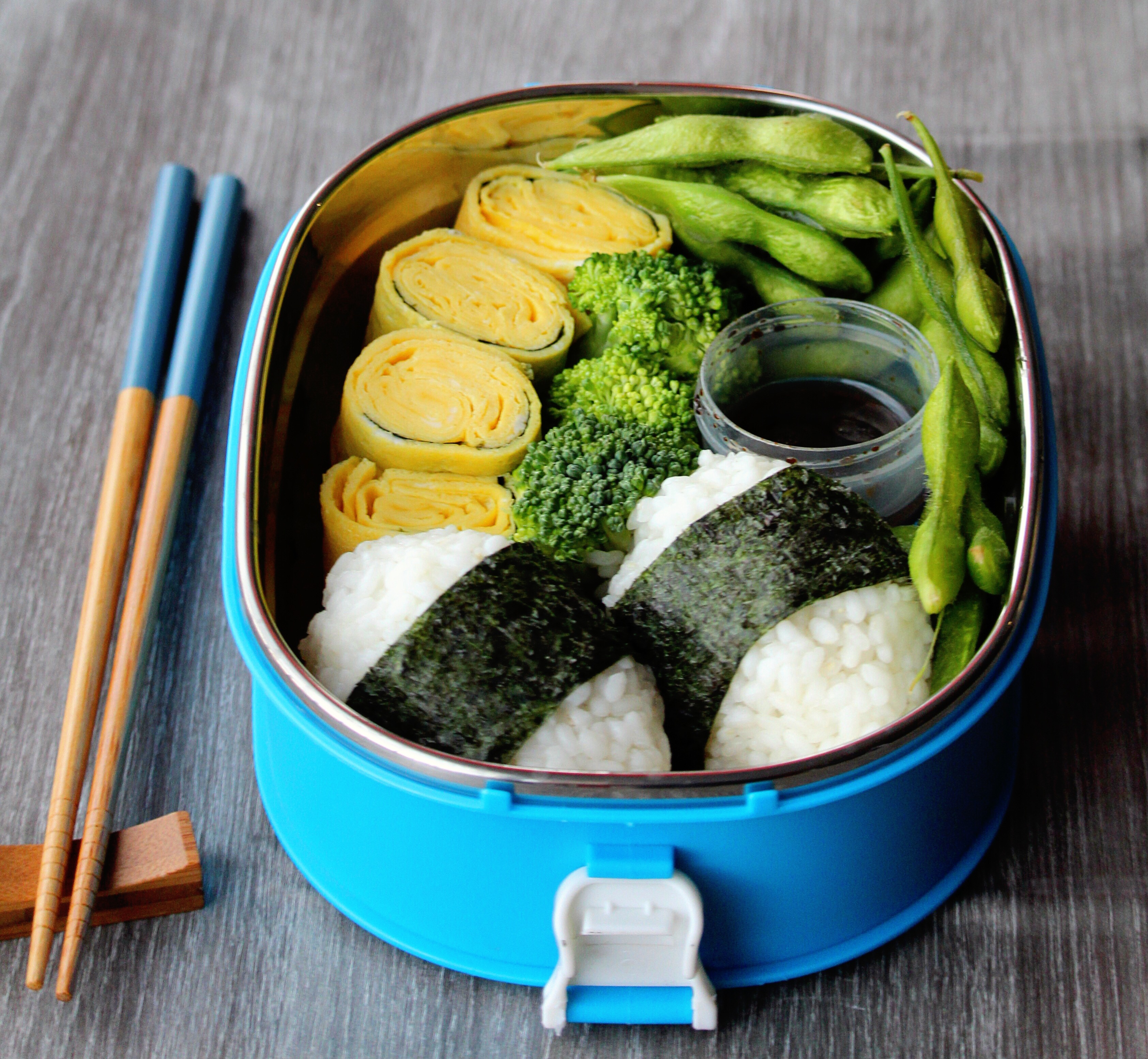 A traditional Japanese bento, this one is different than a basic cheese and cracker one. The onigiri can be created and shaped in cute designs or animal figures, which would be perfect for any kid's lunchtime box.