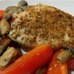 Roasted Pork Chops with Tomatoes, Mushrooms, and Garlic Sauce Rock_lobster
