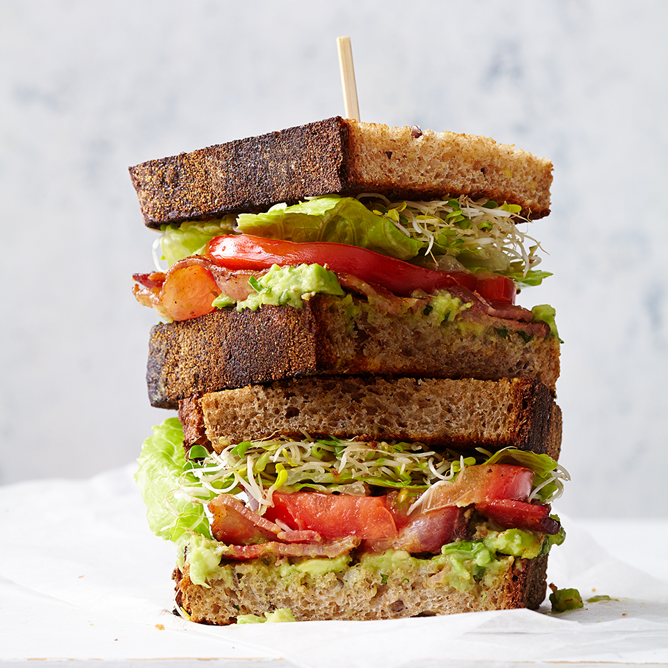 In this healthy BLT recipe, we use a creamy avocado spread flavored with garlic and basil, and add sprouts. Look for sprouted-wheat bread in the frozen section or with other specialty breads at your grocery store.