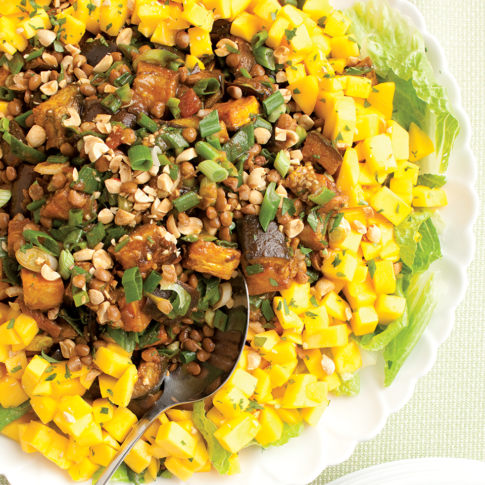 Spiced eggplant, lentils and mangoes combine deliciously in this Indian-inspired vegetarian salad. Customize the spiciness of this by choosing mild, medium or hot versions of salsa, chili powders and curry powder. The flavor is even better when the salad is prepared ahead. Recipe by Nancy Baggett for EatingWell.