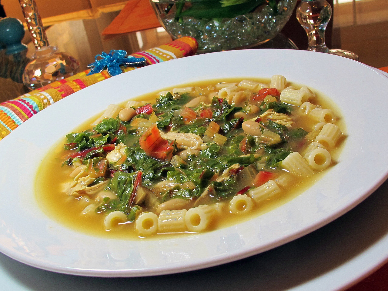 "This hearty soup features the classic Italian pairing of pasta and beans. Cannellini beans and ditalini pasta combine with baby spinach and lots of garlic. It's ready in less than an hour. ""A very yummy soup,"" says WIFE2SP. ""Filling and comforting. I didn't drain the beans because I like the thickness the liquid gives the soup."""