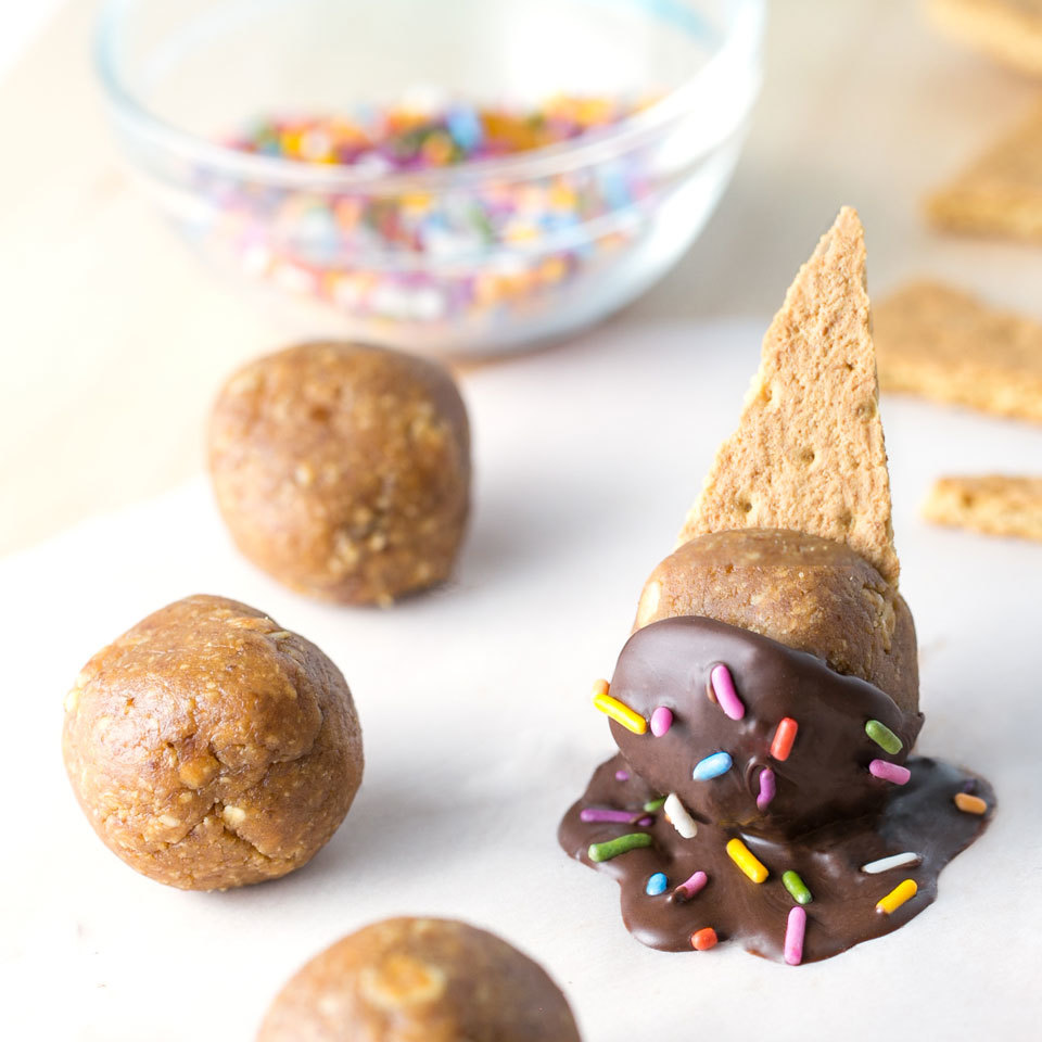 These energy bites, dipped in chocolate and topped with graham crackers, look just like melty ice cream cones, but are packed with energizing protein for a healthier snack kids will love.
