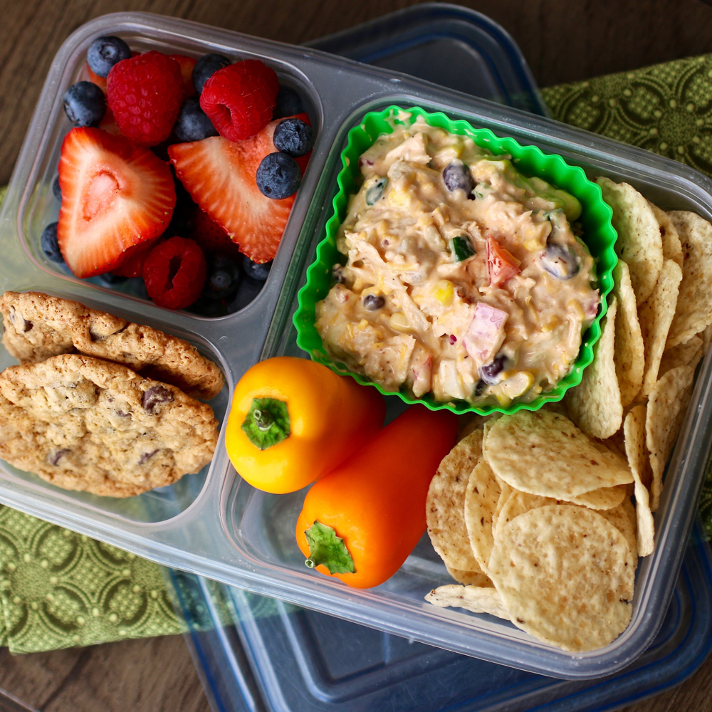 This chicken salad has a nice and spicy kick, and it comes with fresh fruit and delicious Urban Legend Chocolate Chip Cookies for some sweetness to finish the meal off. Plus it takes just 20 minutes to prepare!