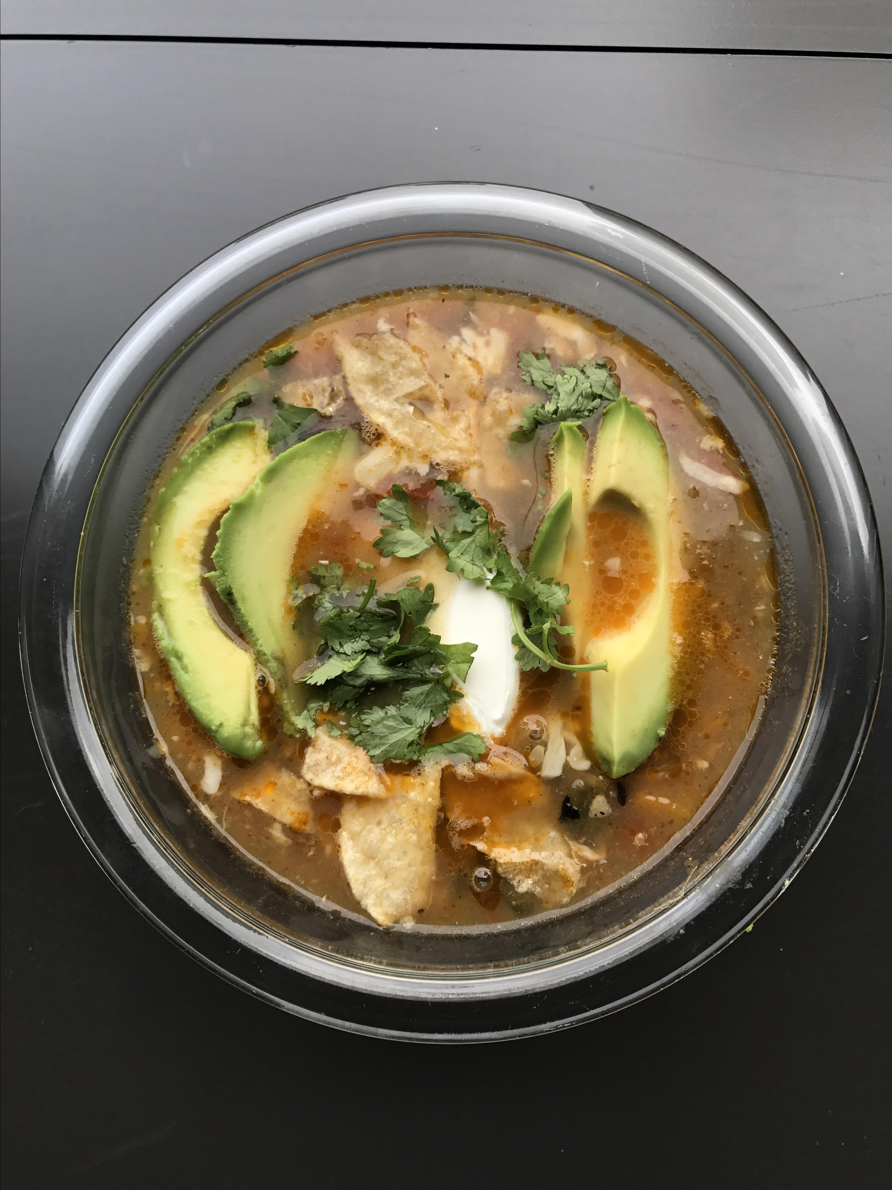 """Here's a hearty version of chicken tortilla soup with layers of flavors, starring veggies, herbs, black beans, and lime juice. """"Top soup with avocado, pepper Jack cheese, fresh cilantro, sour cream, crumbled tortilla chips, and hot sauce. This is great for freezing!"""" says voraciousgirl."""