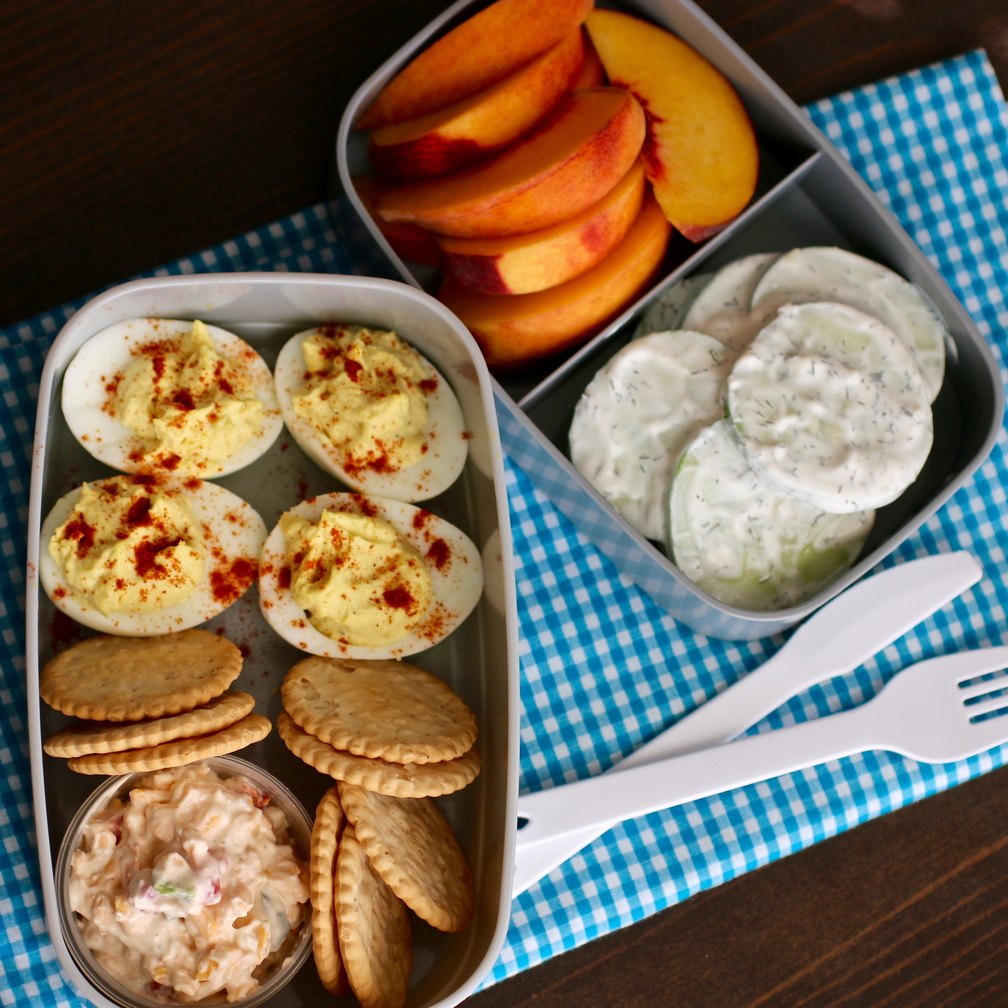 Enjoy a few Southern favorites in this clean, simple bento box. You can indulge in deviled eggs, crackers and cheese, and a creamy cucumber salad that will hit the spot and fill you up fast.