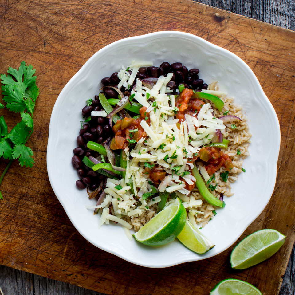 Simple brown rice and black beans serve as the backdrop for sautéed veggies and taco toppings!