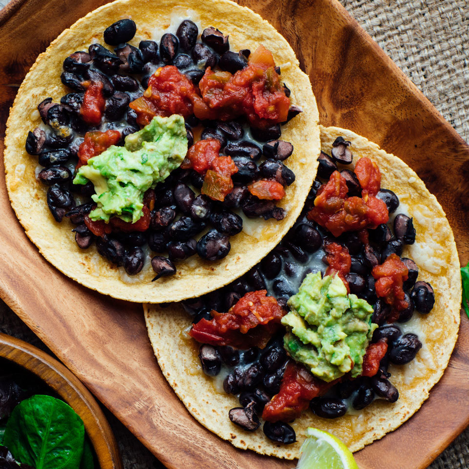 Would you believe us if we said you can have restaurant-style tostadas at home in just 15 minutes? It's no problem! Simply layer black beans and Cheddar onto corn tortillas and toast in the toaster oven. Source: EatingWell.com, October 2017