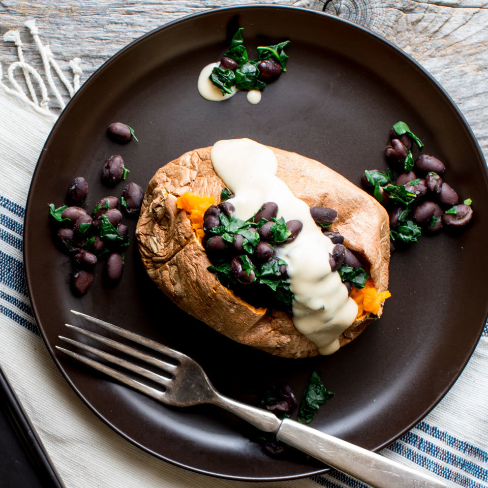 Hearty yet simple to prepare, this stuffed sweet potato with black beans, kale and hummus dressing is a fantastic 5-ingredient lunch for one! Source: EatingWell.com, October 2017