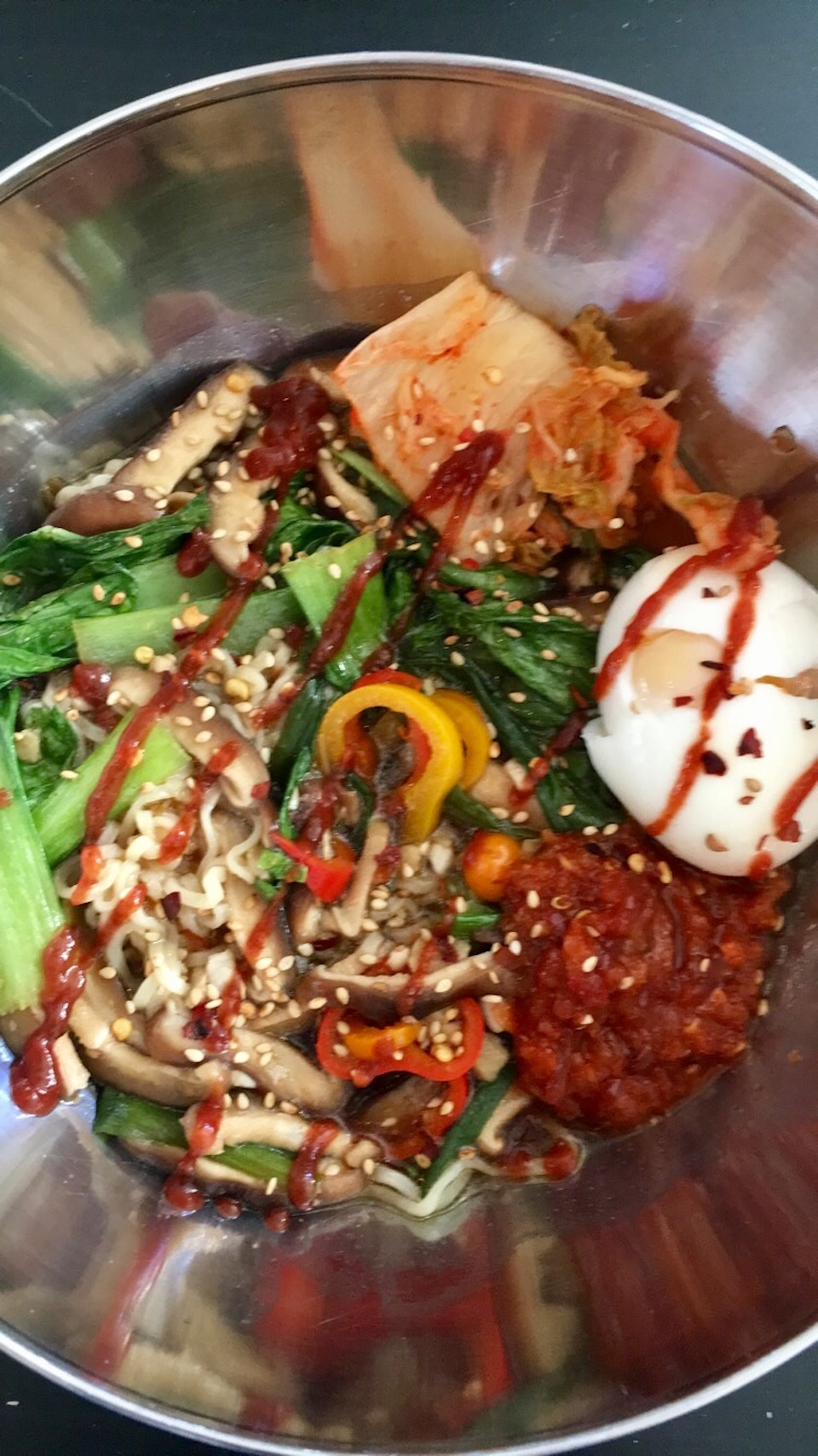 Here's a simple vegetarian ramen recipe with kimchi, mushrooms, sweet peppers, and bok choy.