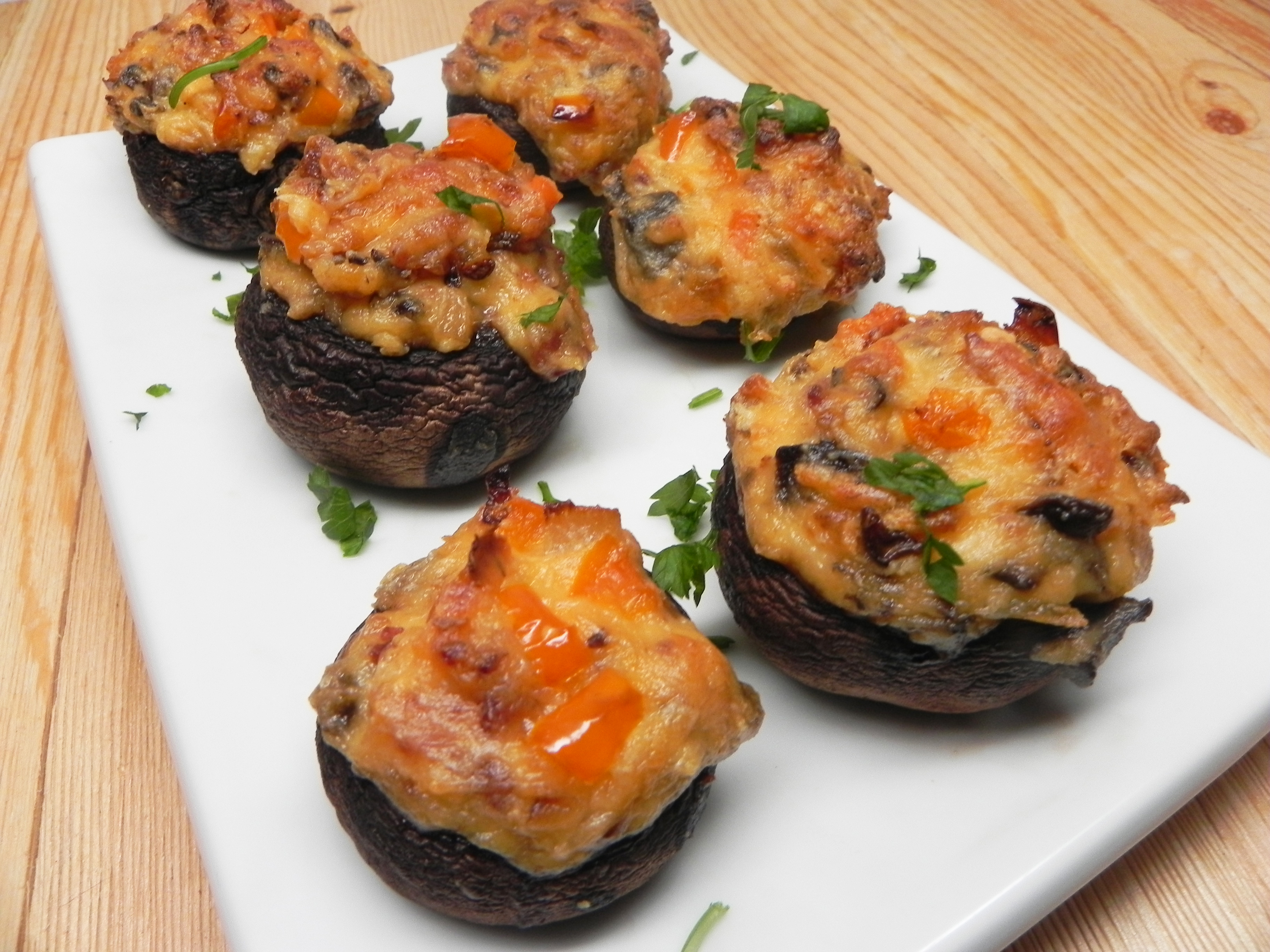 """These are great stuffed mushrooms, the recipe uses sour cream and grated cheese to hold the stuffing together, it is far and away my favorite pre-dinner snack to serve at parties,"" says MumAndMe. You can also make these cheesy mushrooms under the broiler: Bake at 325 degrees F until the cheese in bubbly and browned, about 15 minutes.."