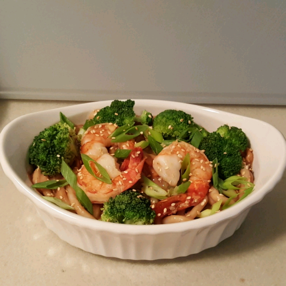 """You'll toss Japanese udon noodles with broccoli, shrimp, and a simple peanut butter sauce, and garnish with chopped peanuts. """"A sweet, salty, nutty dish that can be cooked up in less than 15 minutes,"""" says w. """"Measurements for the sauce can be adjusted for your taste, but with these ingredients, you can't go wrong! I use pre-washed, pre-cut broccoli florets to cut down on prep time as well."""""""