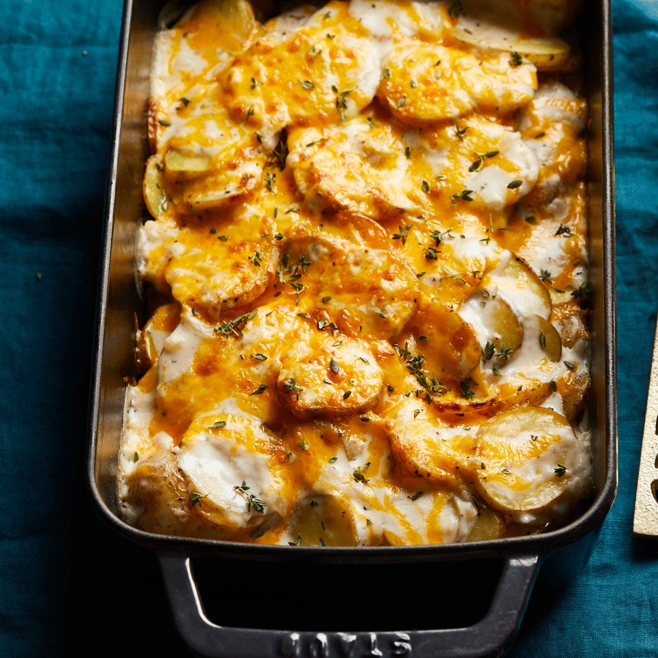In this easy scalloped potatoes recipe, sliced potatoes are roasted in the oven before being mixed with a simple, creamy stovetop sauce and sprinkled with Cheddar cheese. A few minutes under the broiler turns the dish golden and crispy. Source: EatingWell.com, October 2017