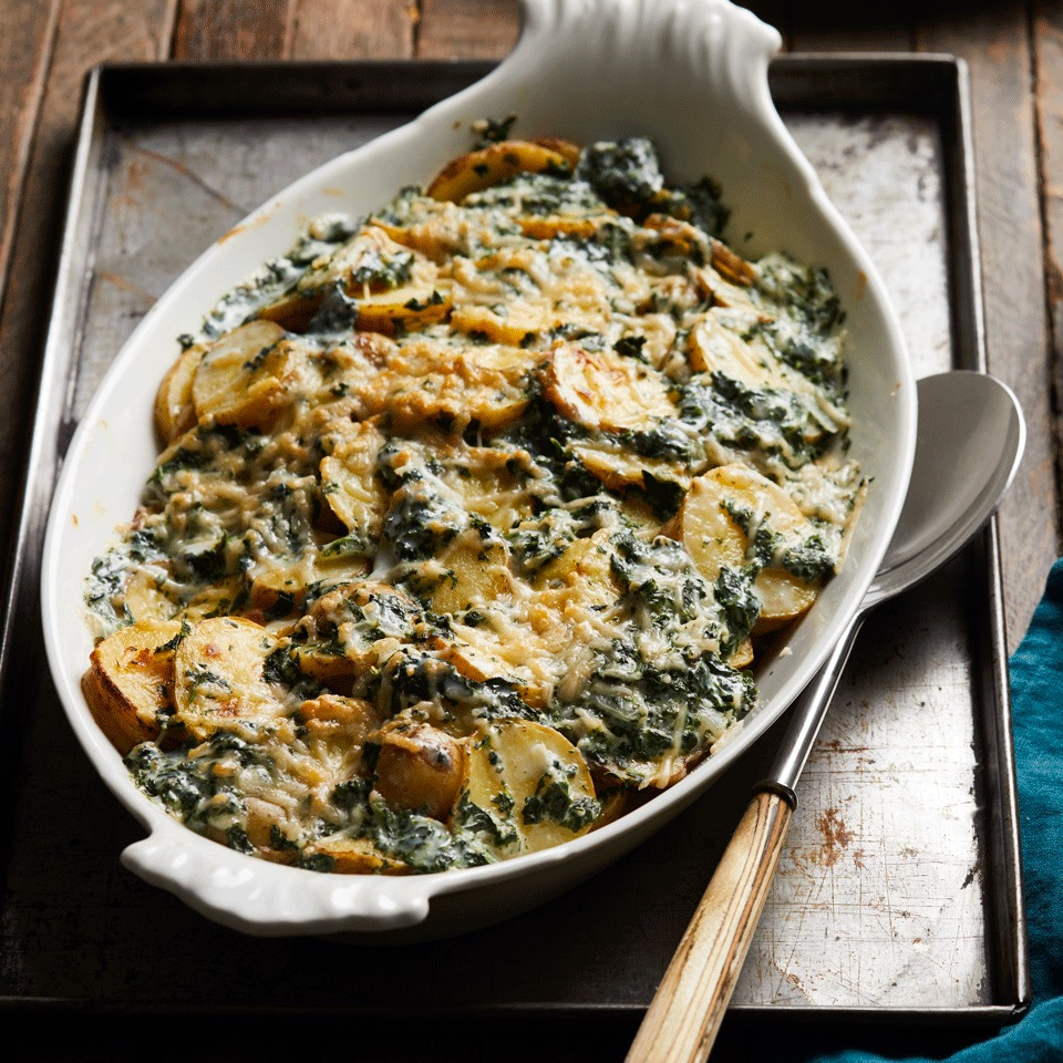 Classic scalloped potatoes get a burst of color, heartier texture and a healthy update with the addition of chopped spinach. The greens in this side dish also create a nice contrast to the creamy, velvety potatoes.