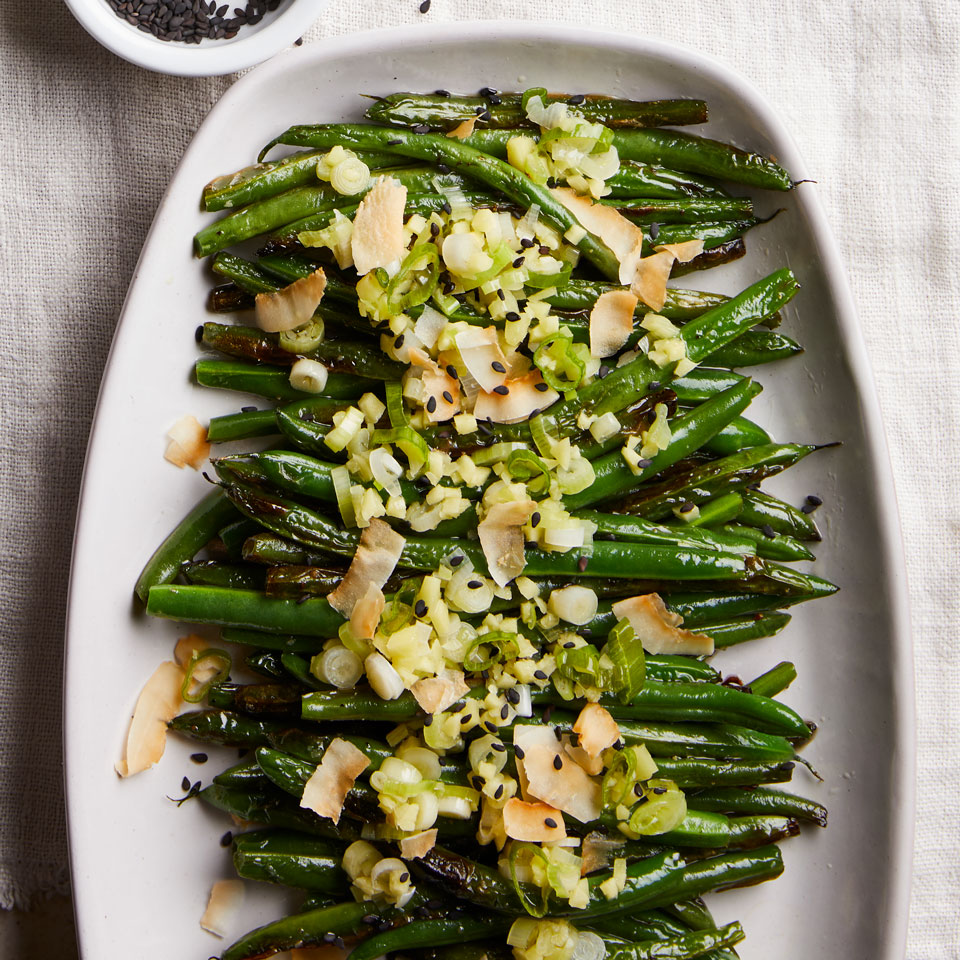 Coconut helps accentuate the natural sweetness of green beans in this healthy skillet-roasted vegetable side dish. A drizzle of the ginger- and scallion-infused oil rounds out the flavors.