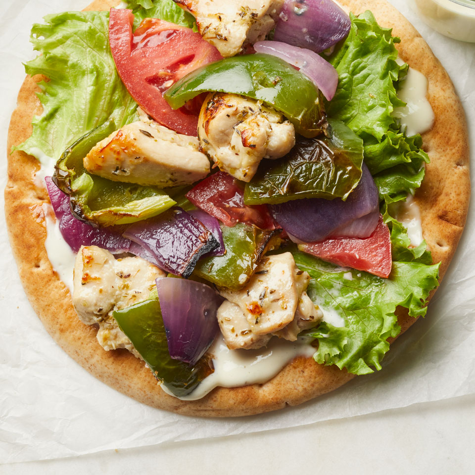 We love this healthy veggie and chicken recipe all bundled up in pita, but you can also serve it over brown rice, drizzled with the mayo sauce too. Source: EatingWell Magazine, November/December 2017