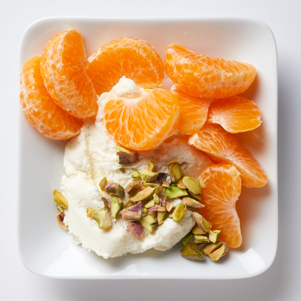 Skip sugar-sweetened yogurt and try ricotta instead. Topped with fresh fruit and nuts, it's the perfect healthy snack.