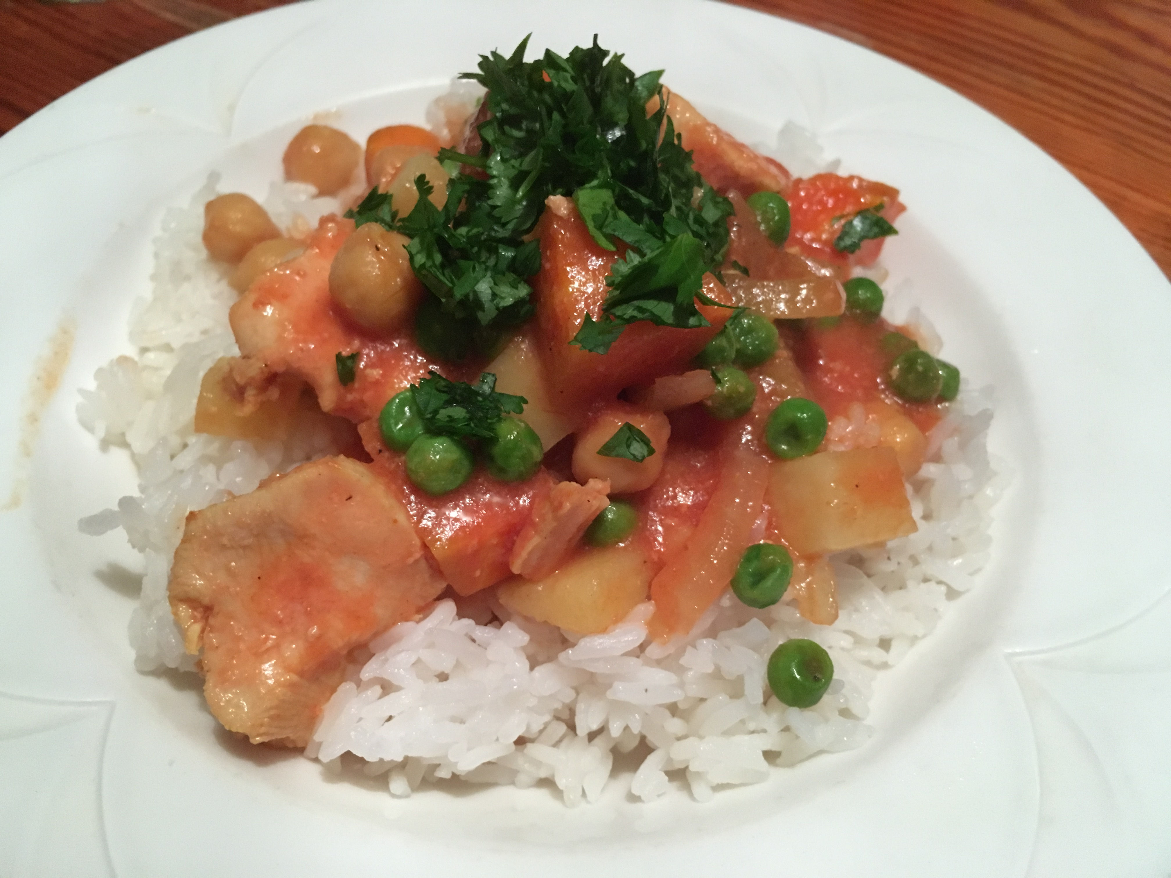 Boneless Chicken Breast with Tomatoes, Coconut Milk, and Chickpeas in the Slow Cooker