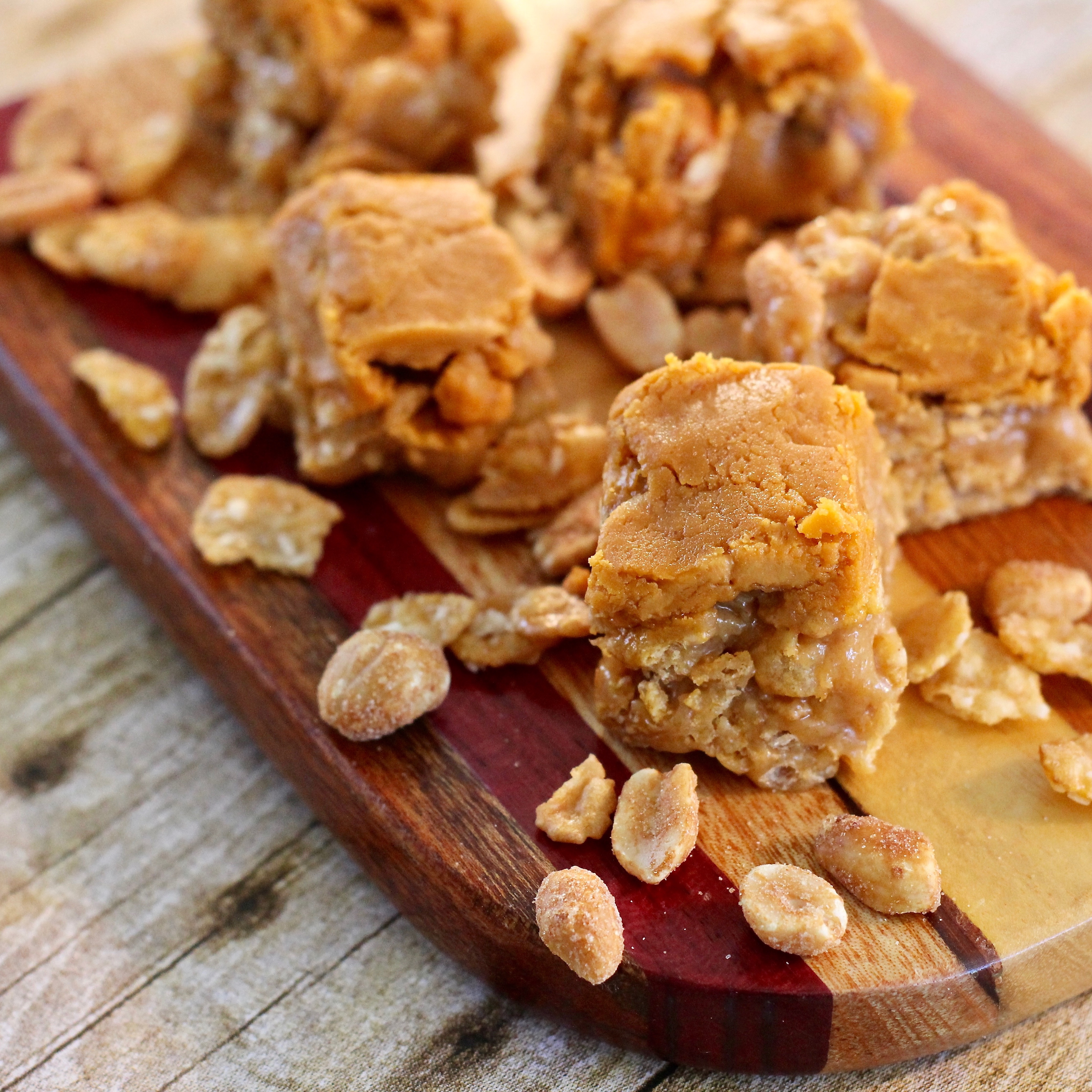 "These golden gems are packed with peanut butter, peanuts, butterscotch chips and of course, cornflakes. Recipe creator Susan Hignight shares, ""This has been a longtime family favorite. Very easy to make and a great choice for peanut butter lovers. The lighter you press the mixture into the pan, the more tender the candy will be."""
