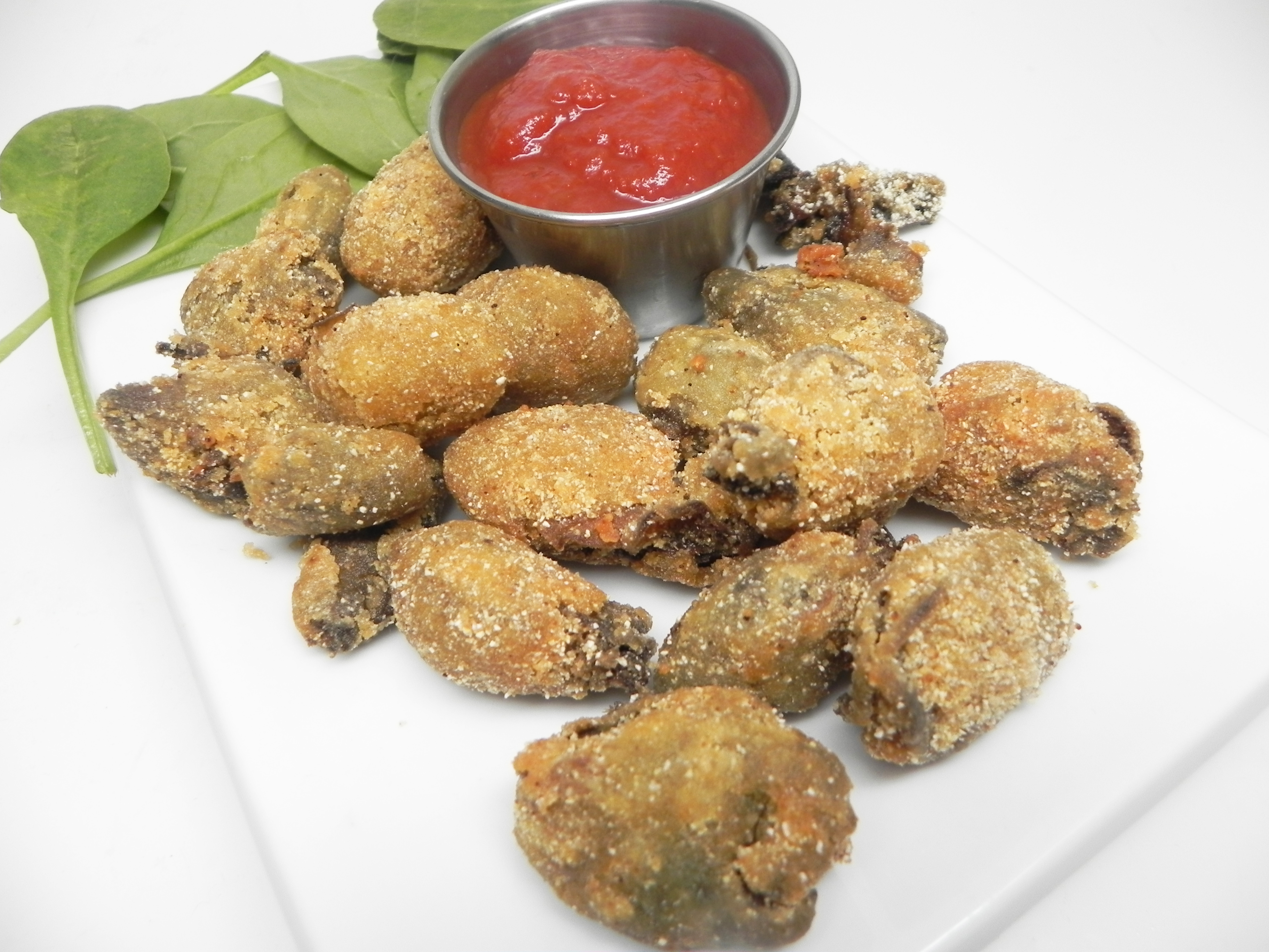 """These Southern-style deep-fried oysters get a spicy cornmeal coating, starring Cajun seasoning. Fry them up to golden and crispy. """"This came out wonderful,"""" says WONK. """"Will be eating these again and again."""""""