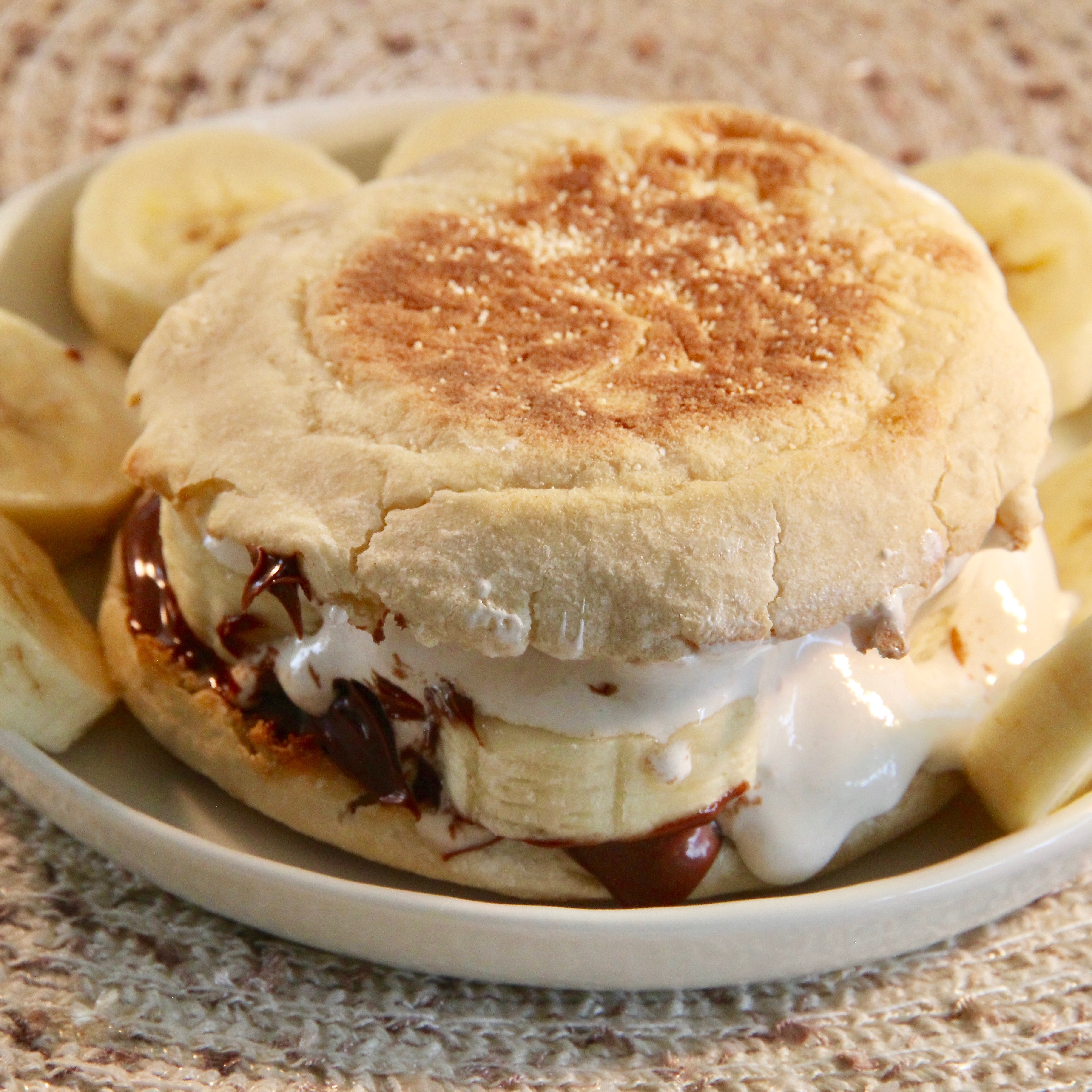 """Breakfast sandwiches don't get easier than this! Slices of banana and schmears of Nutella and marshmallow cream are sandwiched between crisp slabs of toasted English muffin.""""Super easy and delicious sandwich to make for breakfast or a snack,"""" says alycia."""