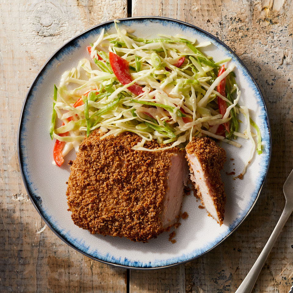 Panko breadcrumbs and a high-heat oven lend satisfying crispiness to pork chops without frying. The miso-flavored chops pair with coleslaw, here updated with snow peas, red bell pepper and Asian flavors like ginger, to round out this healthy 400-calorie meal that's ready in under an hour.