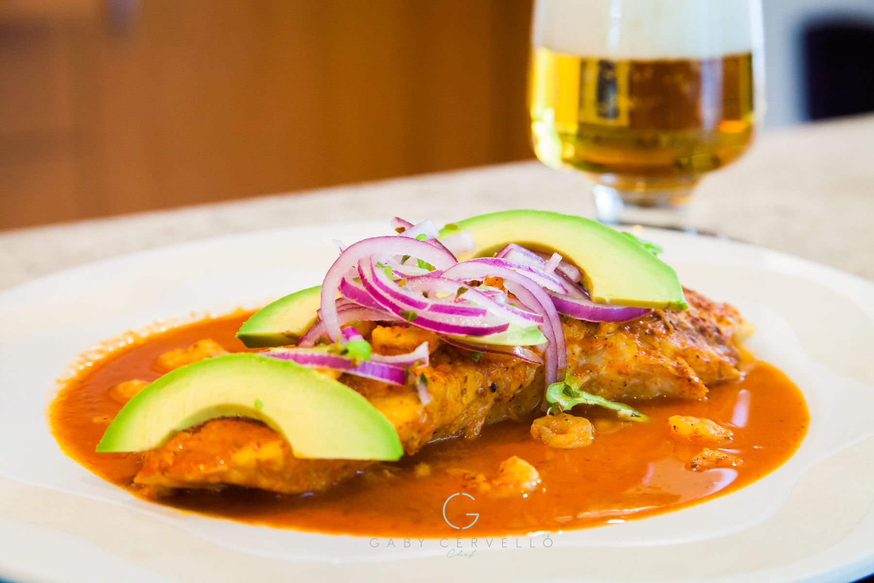 """'These are typical flavors of Southeast Mexico,"""" says Chef Gaby Cervello. """"White fish fillets and shrimp are marinated with achiote, orange juice, lemon, and spices, baked in the oven, and served with habanero sauce and red onion. You can use any white fish fillets."""""""