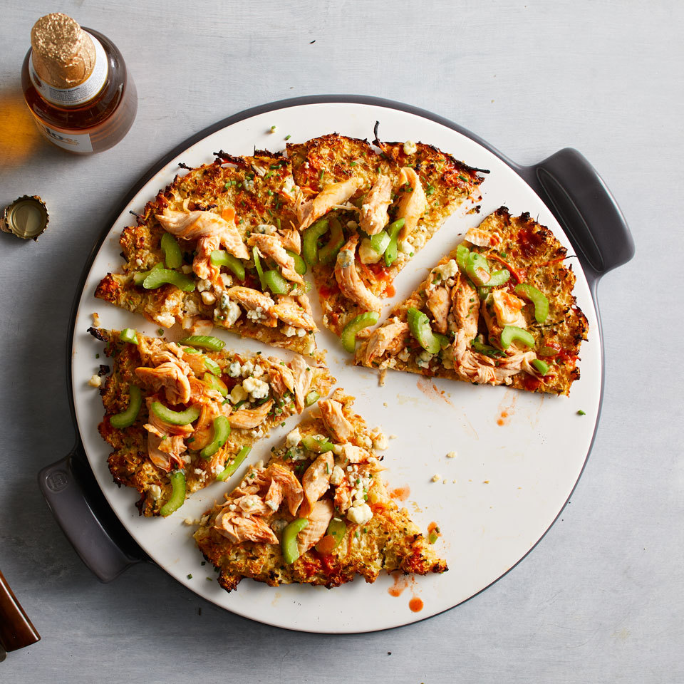Cauliflower rice, egg and shredded mozzarella combine to make an easy low-carb pizza crust. Top the gluten-free pizza with tangy Buffalo sauce, chicken and blue cheese for a flavorful dinner or game-day favorite. Fresh celery is added at the end for cool crunch. Source: EatingWell.com, November 2017