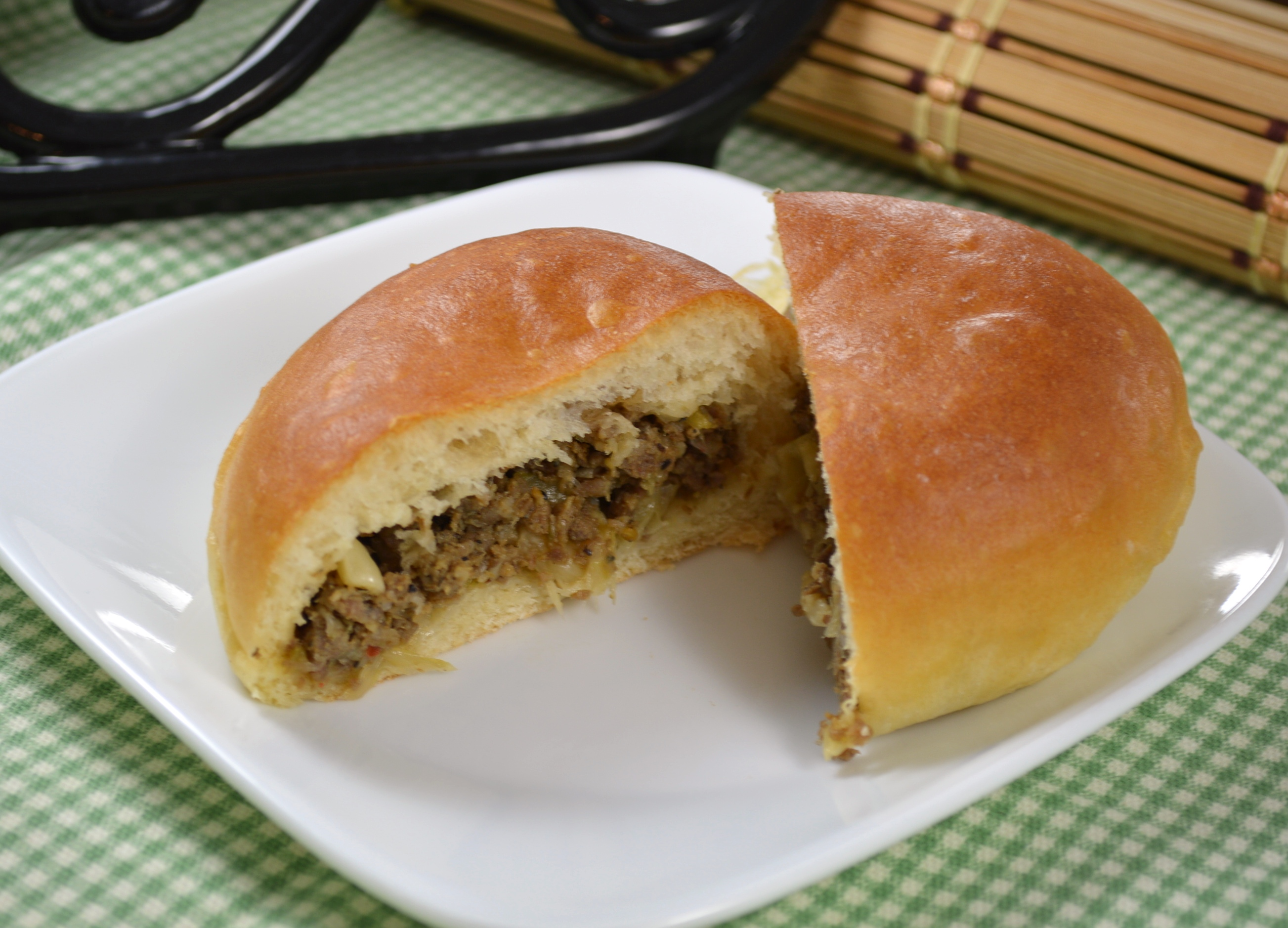 """Sweet dinner rolls are stuffed with a ground beef, onion, and cabbage mixture. """"These turned out really good,"""" says MYSTY1. """"They taste like small burgers. The bread was so soft with a sweetness to it. I could have eaten the bread by itself."""""""