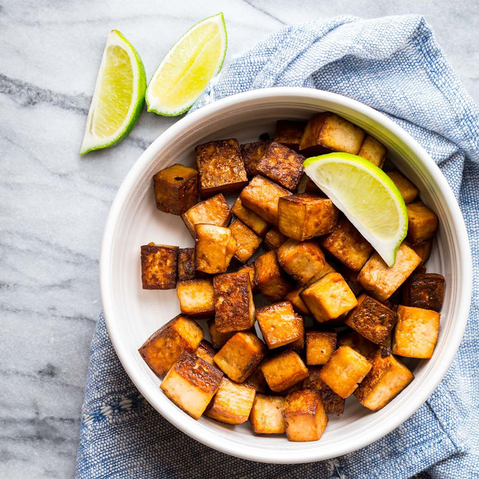 Here we marinate tofu cubes in soy sauce and lime juice with a touch of toasted sesame oil, then roast them--perfect tofu every time.