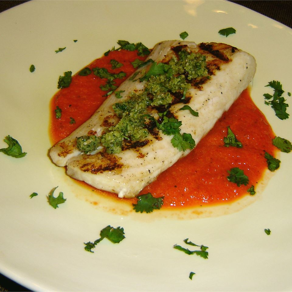 """""""Use your grill to give mahi-mahi a lovely smokey aroma. The red pepper and cilantro pesto adds color and texture to this flavorful dish,"""" says CookinginFL. """"Try serving with yellow rice or sugar snap peas for an amazing meal. You could easily adapt this recipe for other types of fish like snapper or swordfish."""""""