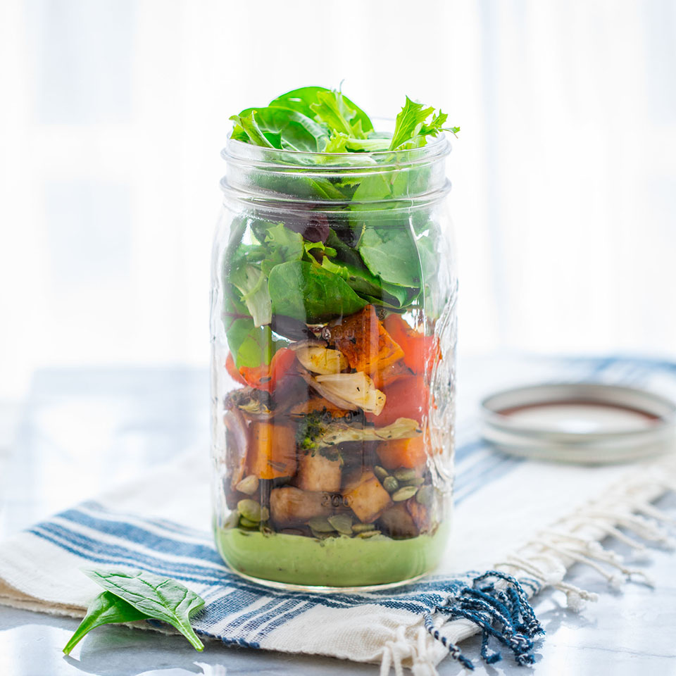 This vegan mason jar salad is easy to pack up and take for lunch. Layering the creamy cashew sauce into the bottom of the jar ensures that your big, bold power salad won't become wilted by the time you're ready to eat.