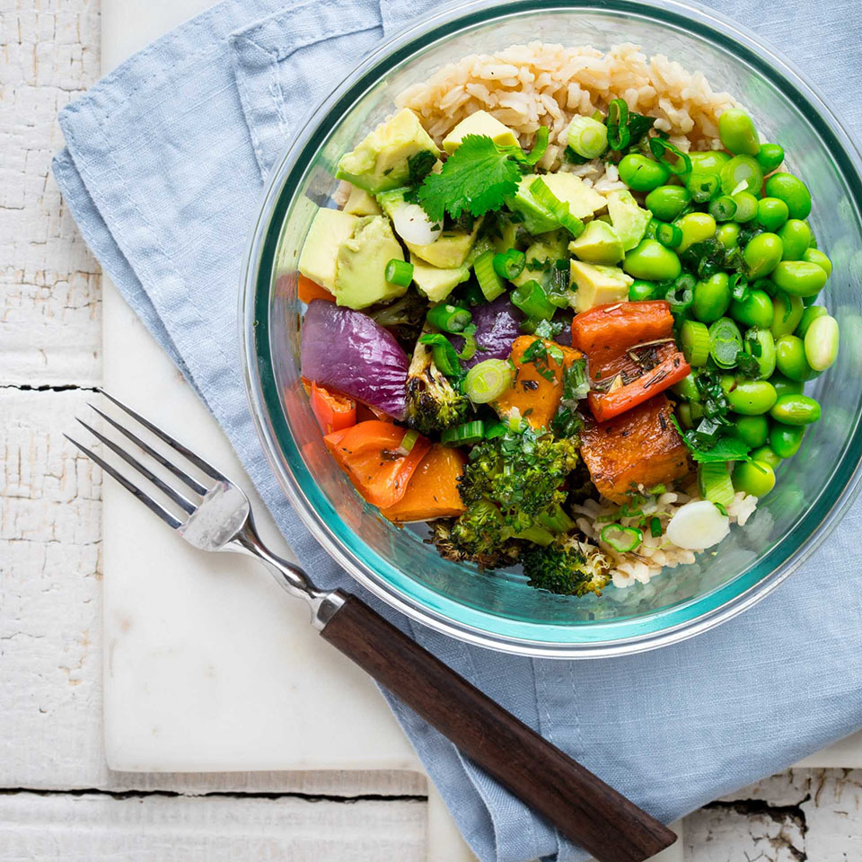 The ingredients in this vegan grain bowl recipe can be prepped ahead for an easy lunch to pack for work. The tangy citrus dressing is a refreshing flavor with the sweet caramel of the roasted sheet-pan veggies. Source: EatingWell.com, December 2017