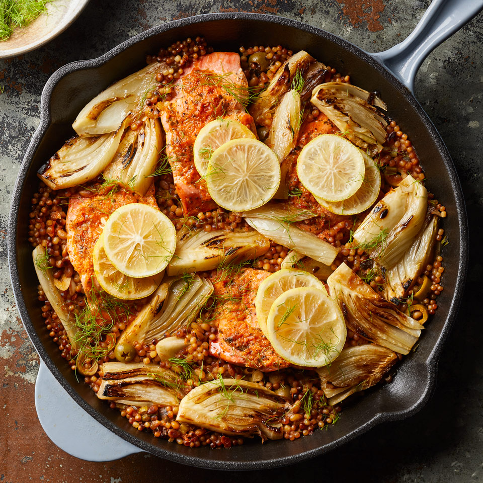 Sun-dried tomato pesto and lemon do double duty to season both the salmon and the couscous in this healthy one-pan dinner recipe. Serve the salmon with extra lemon wedges and a dollop of plain yogurt, if desired.