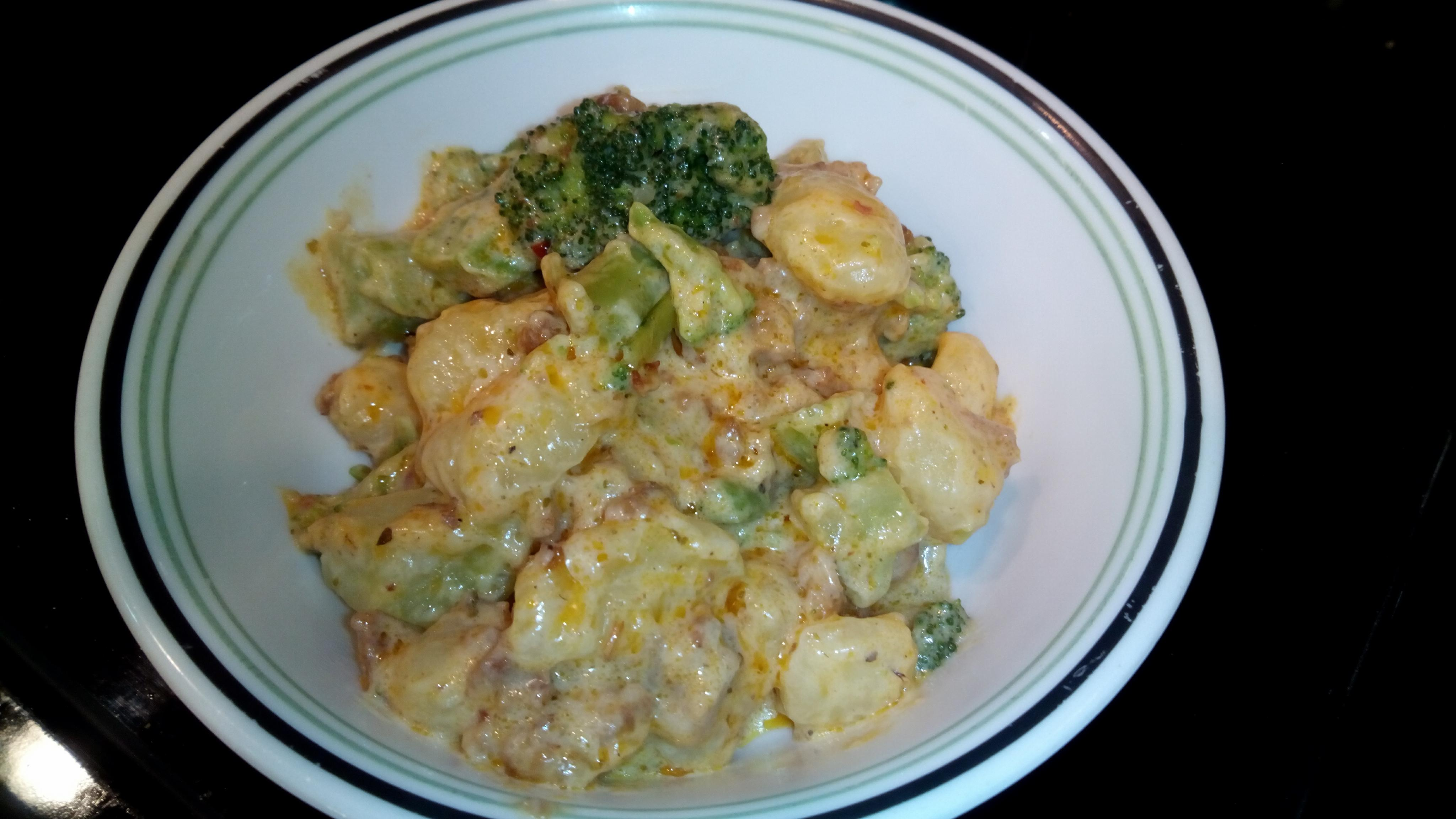 "Packaged potato gnocchi make a knock out dinner with bulk Italian sausage, frozen broccoli, and a jar of Alfredo sauce.  ""A hearty, delicious, and simple meal of gnocchi with sausage cooked on the stove in 20 minutes,"" says Caramia."