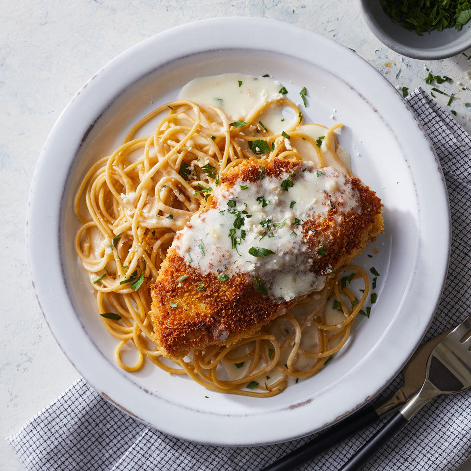 This riff on classic chicken Parmesan replaces the usual marinara with a luscious lemony cream sauce. We've lightened it up by using half-and-half instead of cream, with just-as-delicious results. Serve this lemony chicken dinner with whole-wheat pasta or brown rice. Source: EatingWell.com, January 2018