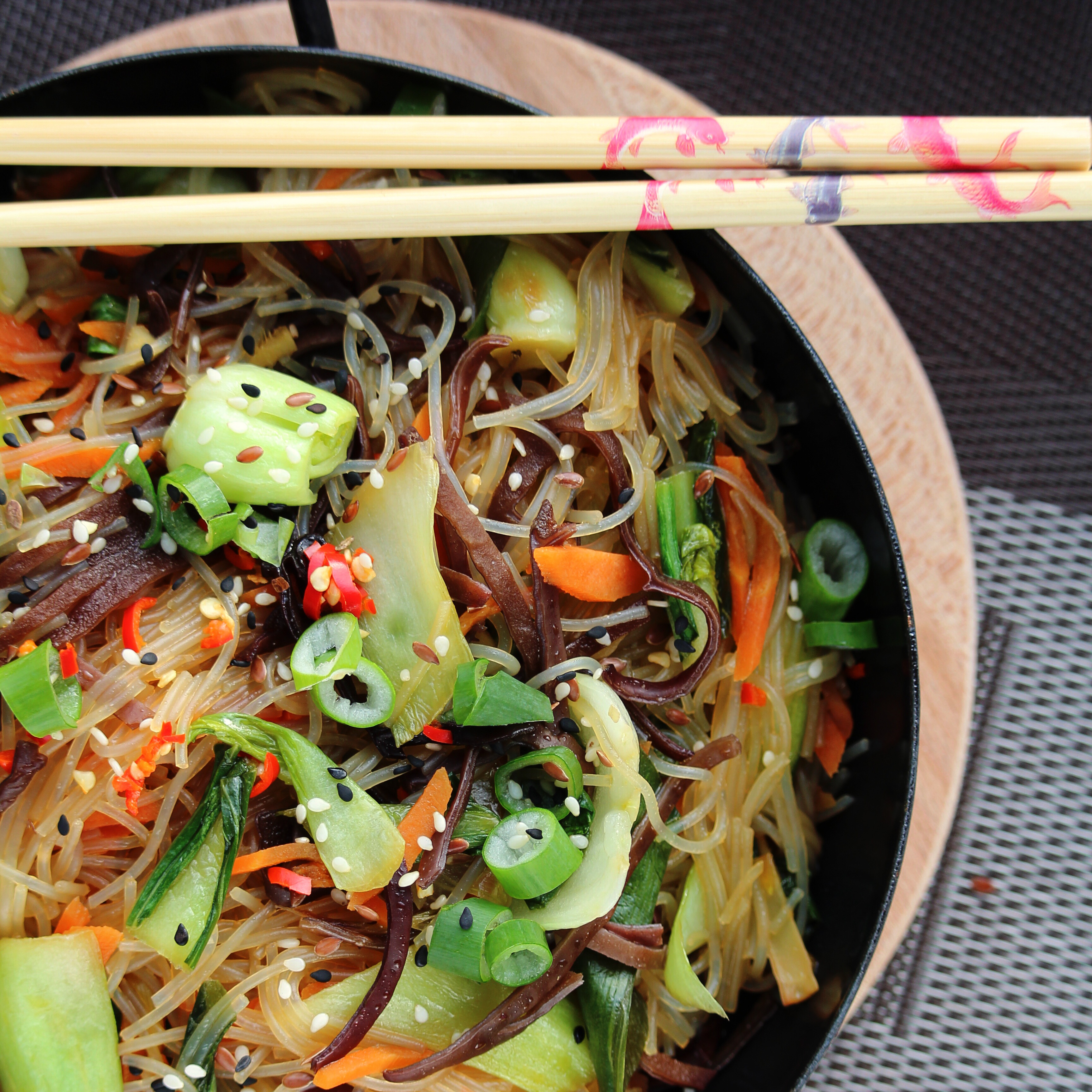 """Traditionally served cold, this vegan Korean dish is packed with sweet potato noodles (dangmyeon) and crunchy vegetables, all tossed in a sweet sesame-soy sauce. """"Delicious!"""" says Buckwheat Queen. """"The method works perfectly and the balance of flavors and textures is spot on."""""""