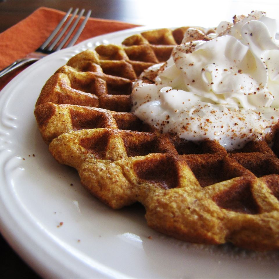 "Buy a second can of pumpkin puree this Thanksgiving and whip up some of these festive waffles. Reviewer CC<3's2bake says, ""Tender crisp and full of delicious flavor. We leave out the nuts and serve with whipped cream and syrup. Heaven!"""