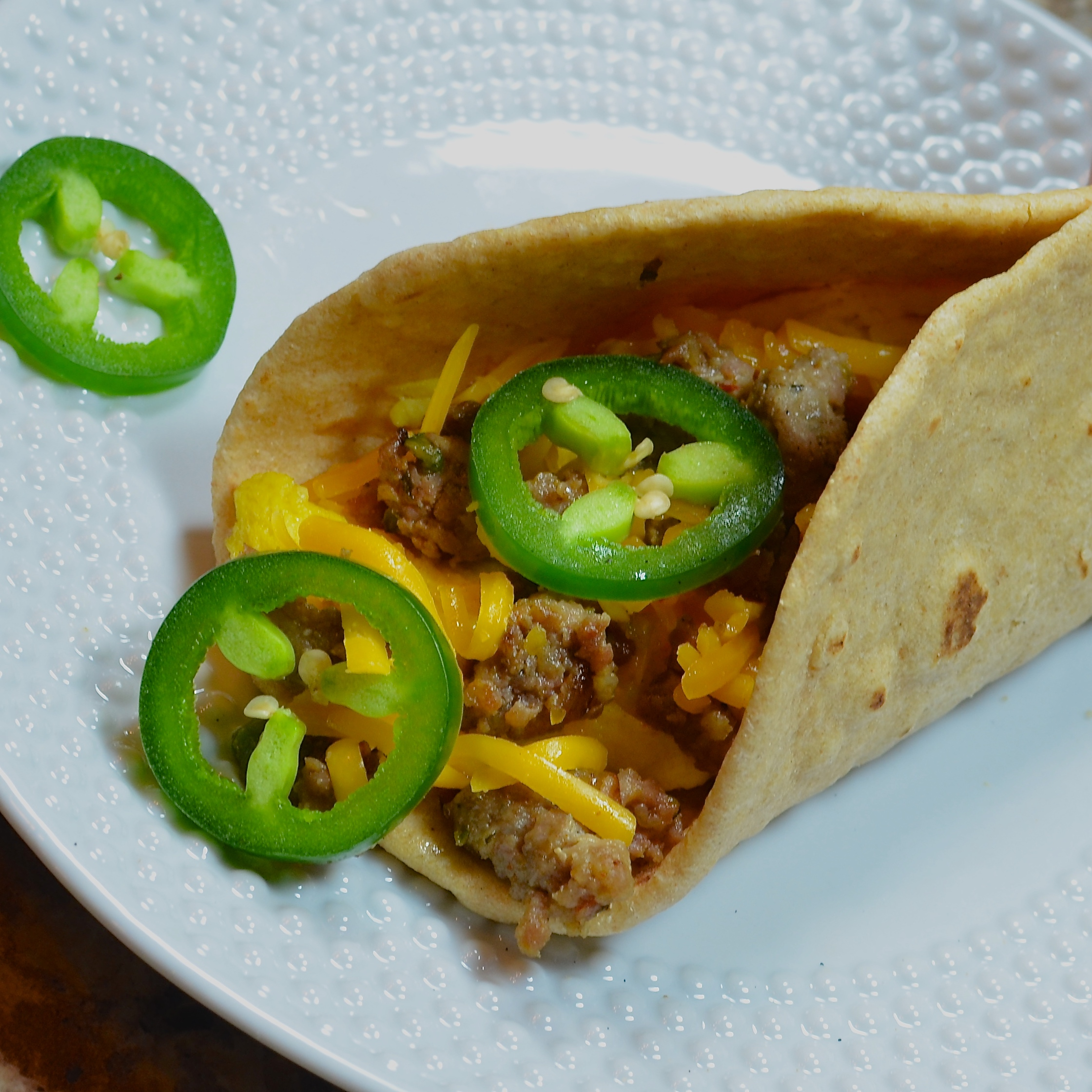 Turkey sausage is fried up with onion and spices, topped with cheese, and served in warm corn or flour tortillas. Home cook Lela served hers with eggs and said it was tasty.